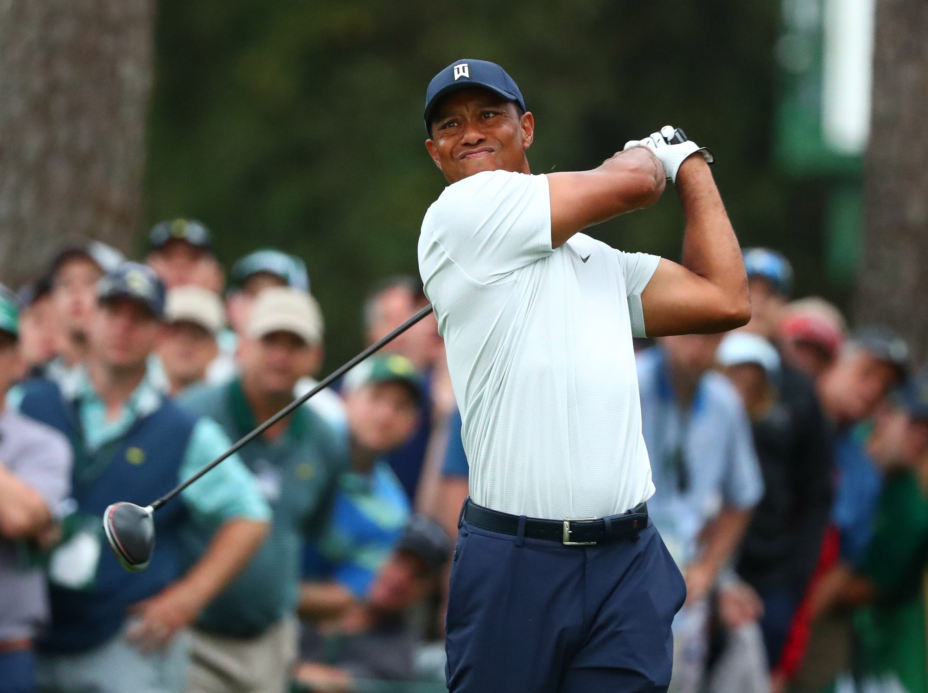 Apr 12, 2019; Augusta, GA, USA; Tiger Woods hits his tee shot on the 17th hole during the second round of The Masters golf tournament at Augusta National Golf Club. Mandatory Credit: Rob Schumacher-USA TODAY Sports