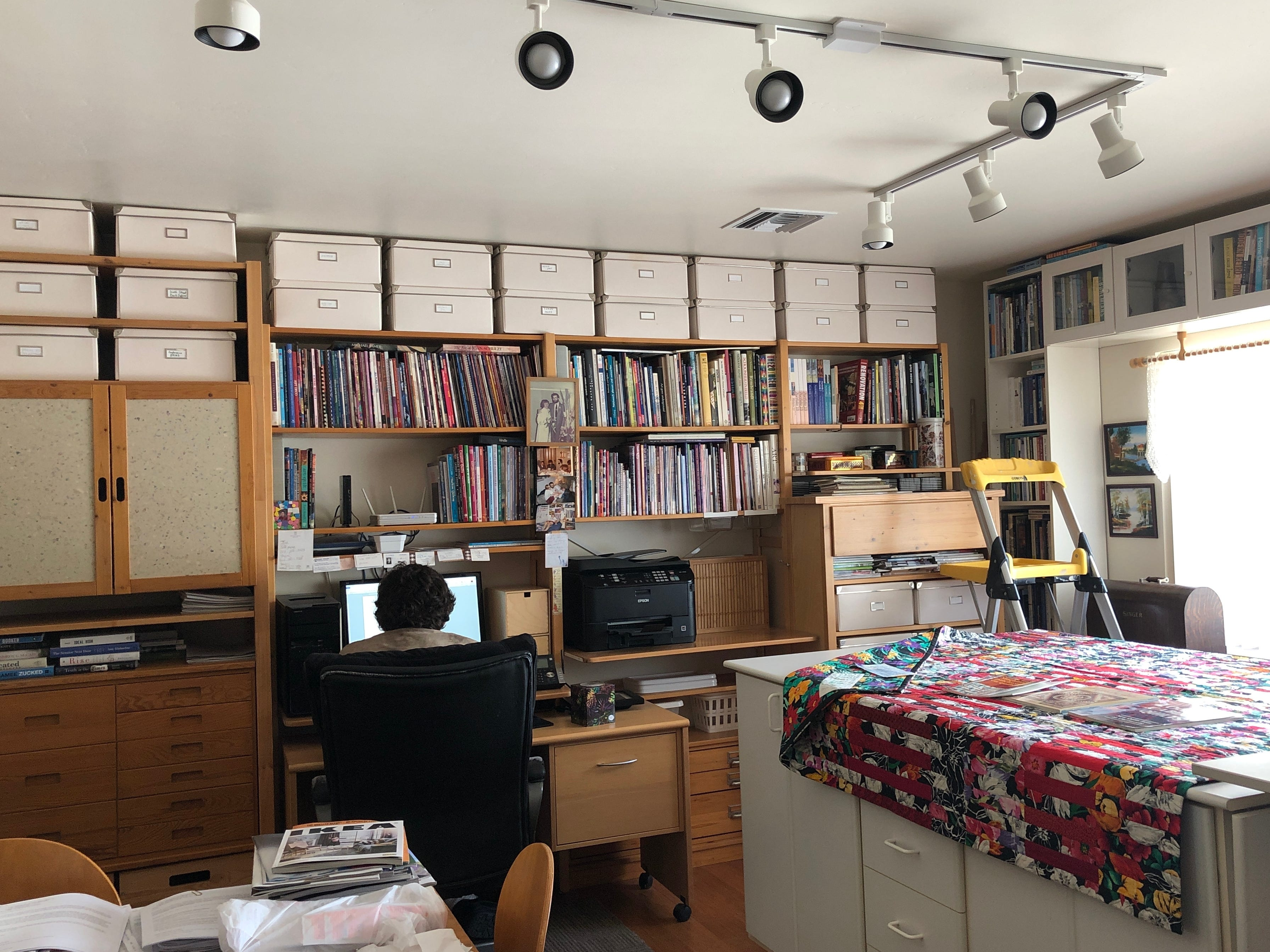 A previous homeowner turned the original garage into a mother-in-law suite with a bathroom and walk-in closet. Meiny Vermaas, a professional artist and quilter, uses it as her workroom and studio, which features LED lighting and north-facing windows for natural light. Her son Theo is working on the computer.