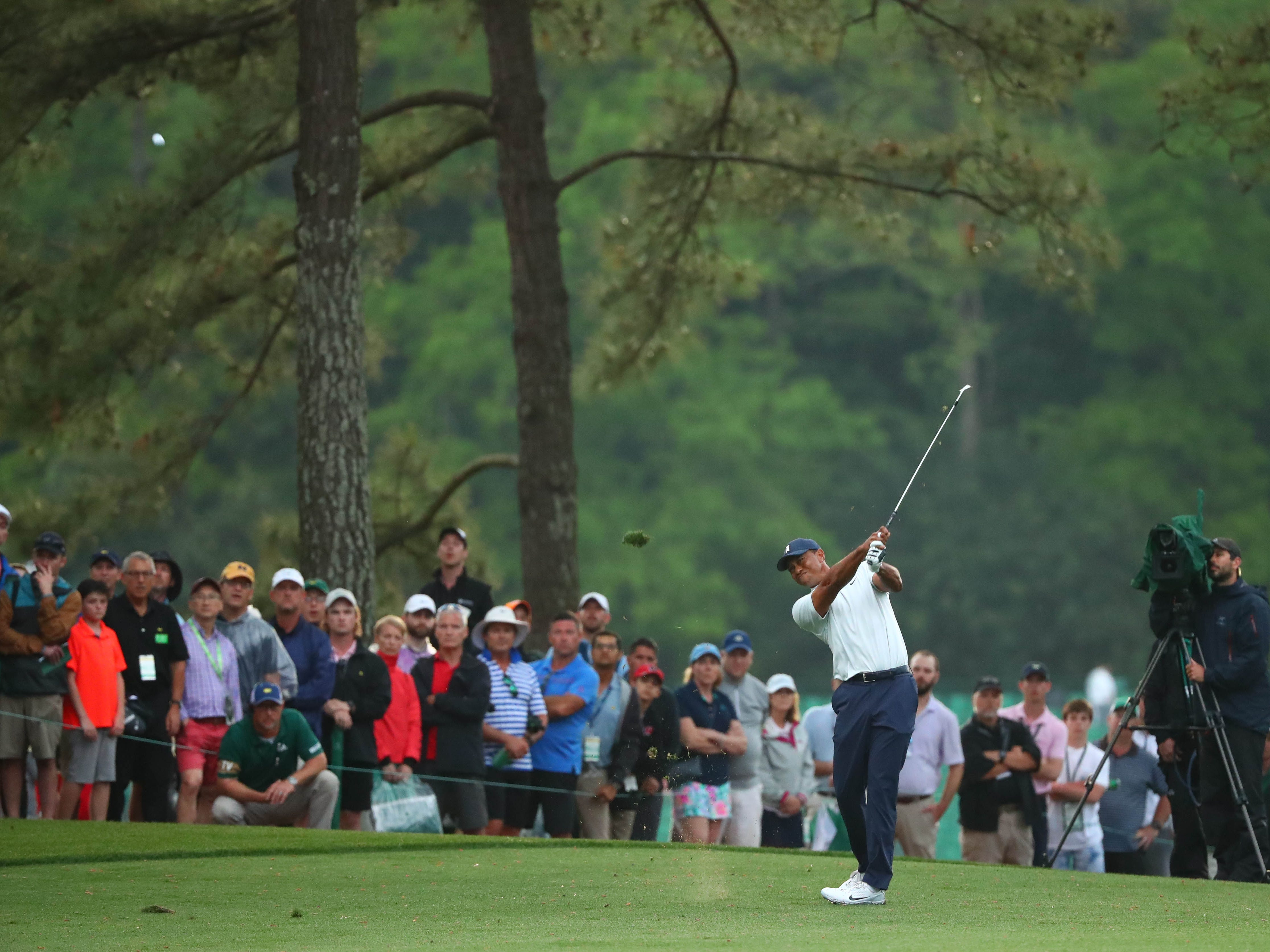 Apr 12, 2019; Augusta, GA, USA; Tiger Woods hits from the fairway on the 17th hole during the second round of The Masters golf tournament at Augusta National Golf Club. Mandatory Credit: Rob Schumacher-USA TODAY Sports