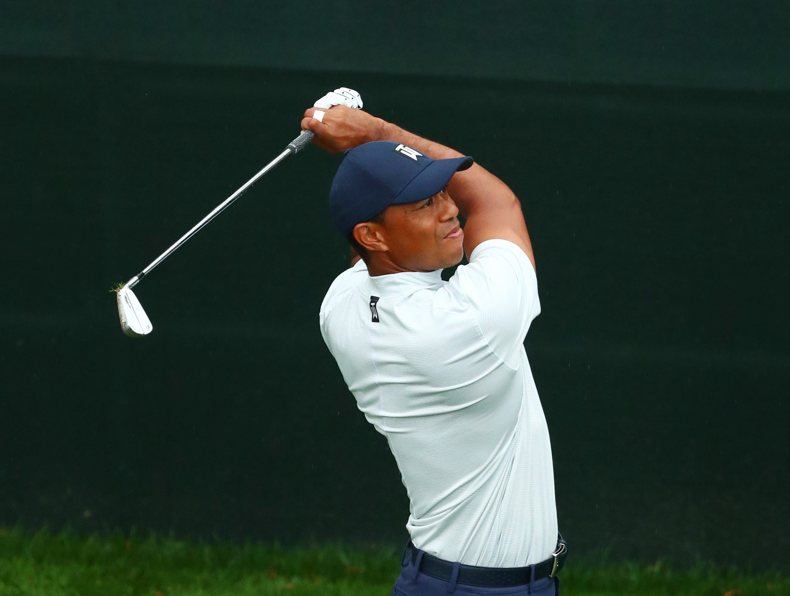 Apr 12, 2019; Augusta, GA, USA; Tiger Woods hits his tee shot on the 16th hole during the second round of The Masters golf tournament at Augusta National Golf Club. Mandatory Credit: Rob Schumacher-USA TODAY Sports