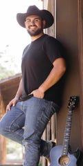 Justin Meek with his guitar.