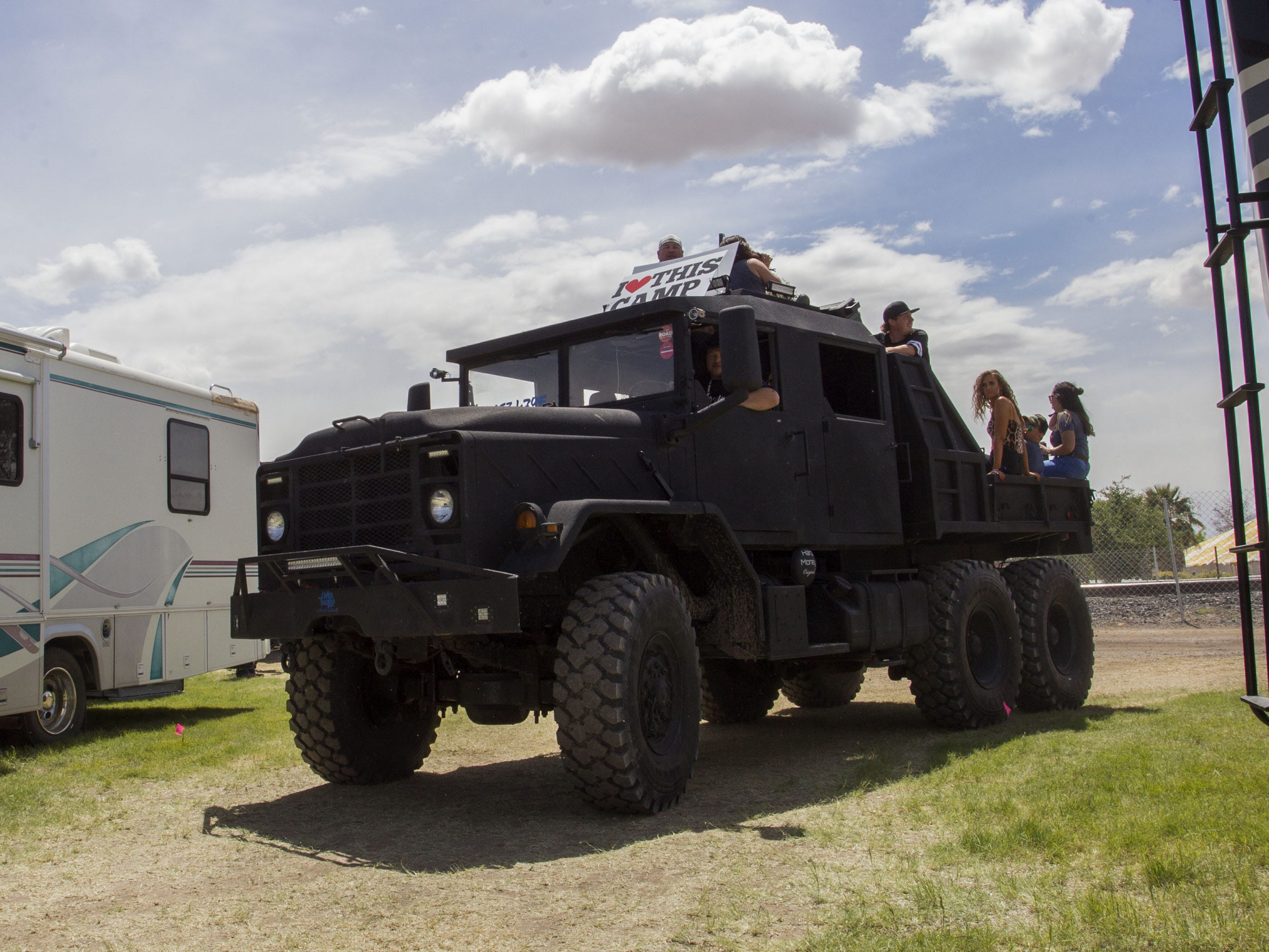 I Love This Camp's big truck hauls concert-goers around Country Thunder Arizona Friday, April 12, 2019, in Florence, Ariz.