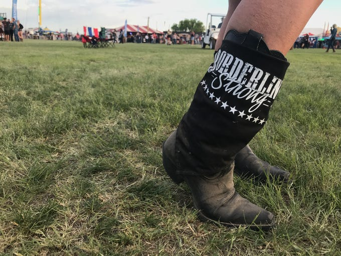 Laura Lynn Meek wears boots in honor of her son, Justin Allen Meek, who was killed in the Nov. 7, 2018, mass shooting at Borderline Bar and Grill in Thousand Oaks, California.