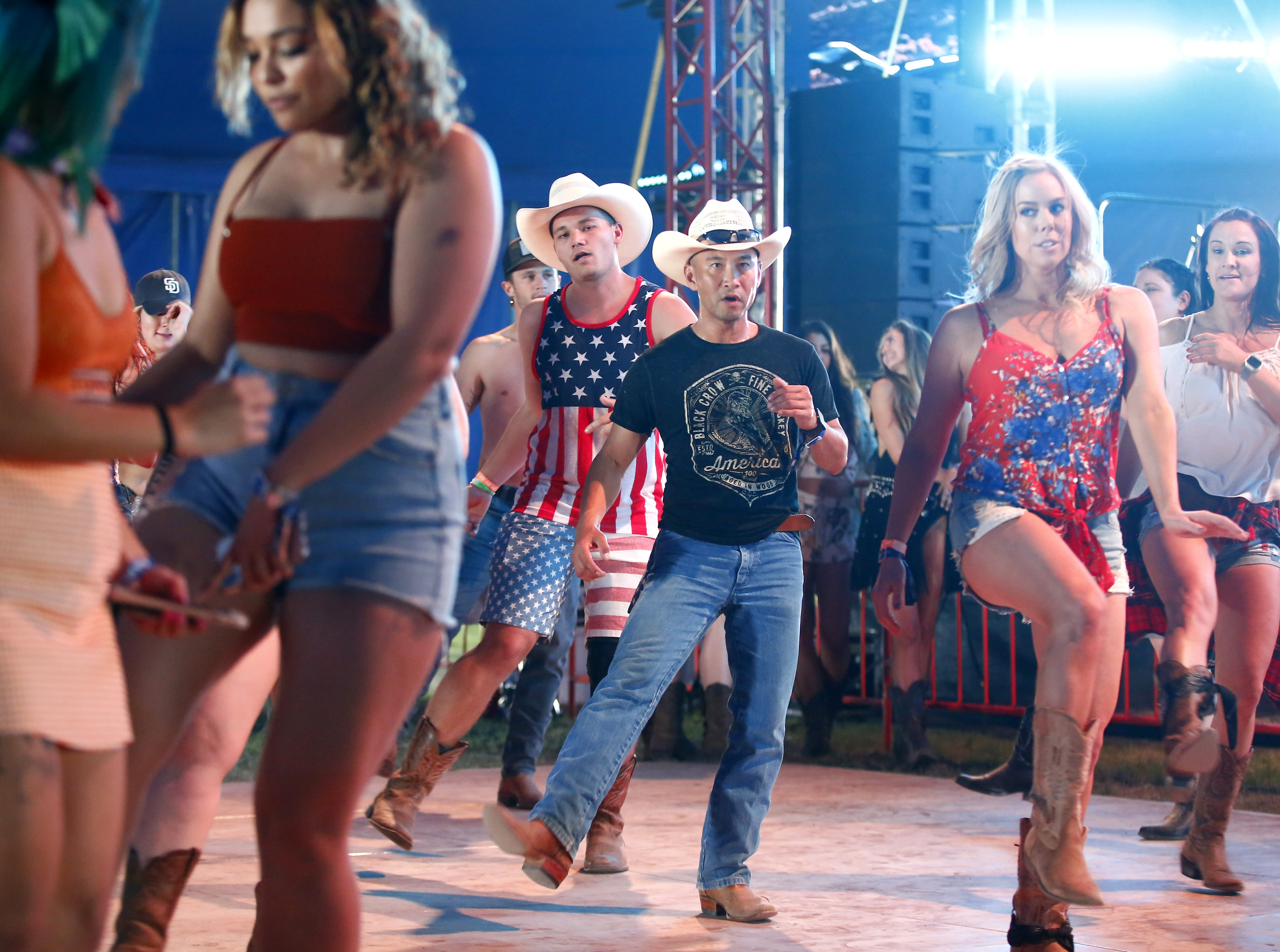 Fans dance during Country Thunder in Florence, Ariz., on Friday, April 12, 2019.