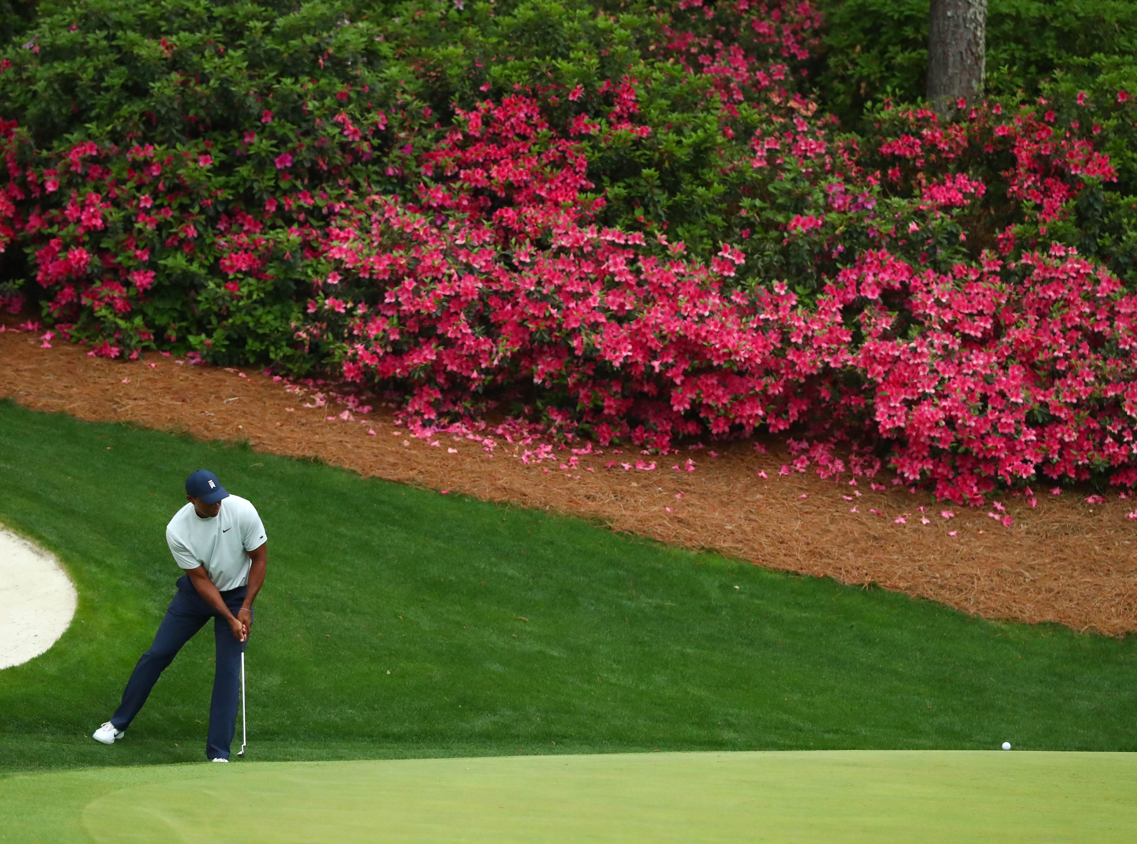 Apr 12, 2019; Augusta, GA, USA; Tiger Woods putts on the 13th green during the second round of The Masters golf tournament at Augusta National Golf Club. Mandatory Credit: Rob Schumacher-USA TODAY Sports