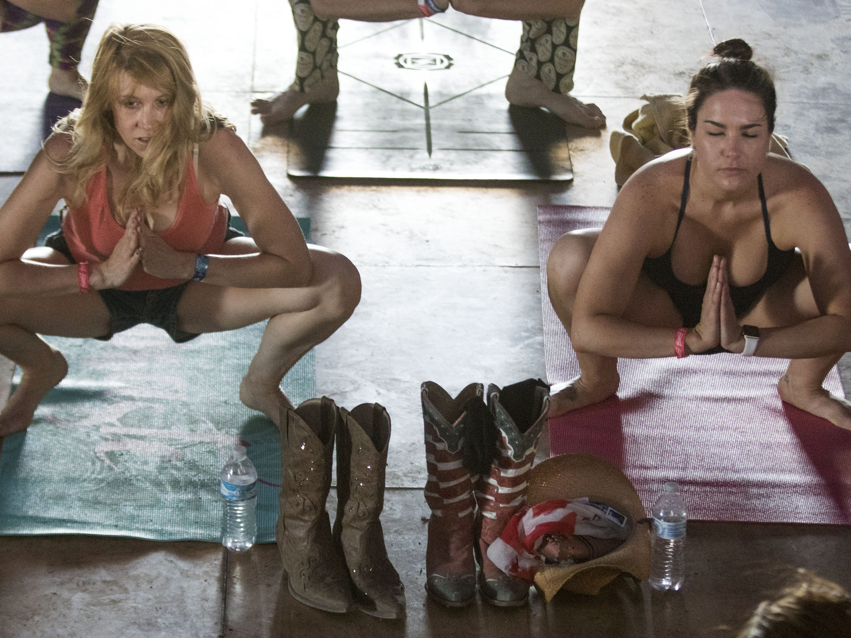 Women practice yoga during a session at Country Thunder Arizona Saturday, April 13, 2019, in Florence, Ariz.