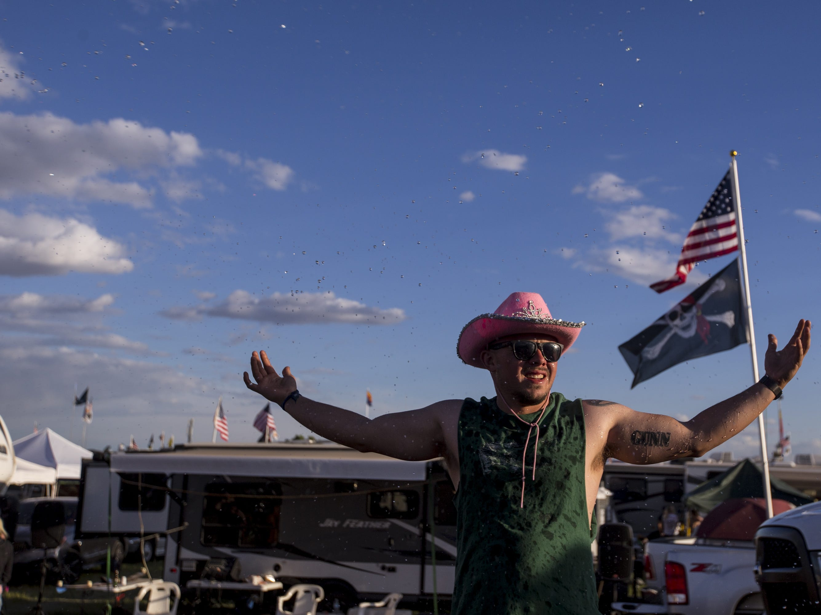 Tanner Novak is sprayed with water at the Crazy Coyote campground on Friday, April 12, 2019, during Day 2 of Country Thunder Arizona in Florence, Ariz.