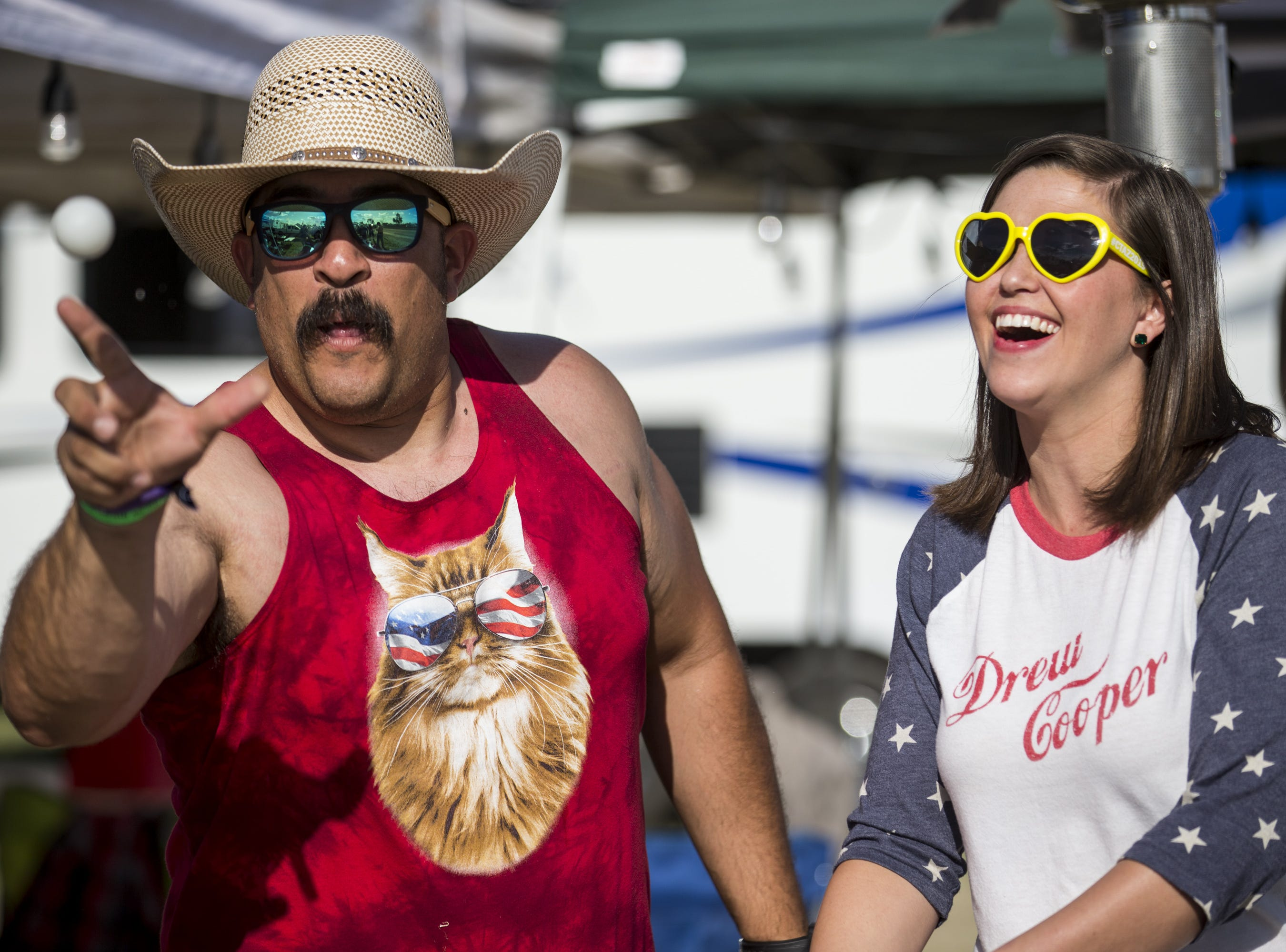 DJ Anaya and Kaylee Donath play beer pong on Friday, April 12, 2019, during Day 2 of Country Thunder Arizona in Florence, Ariz.