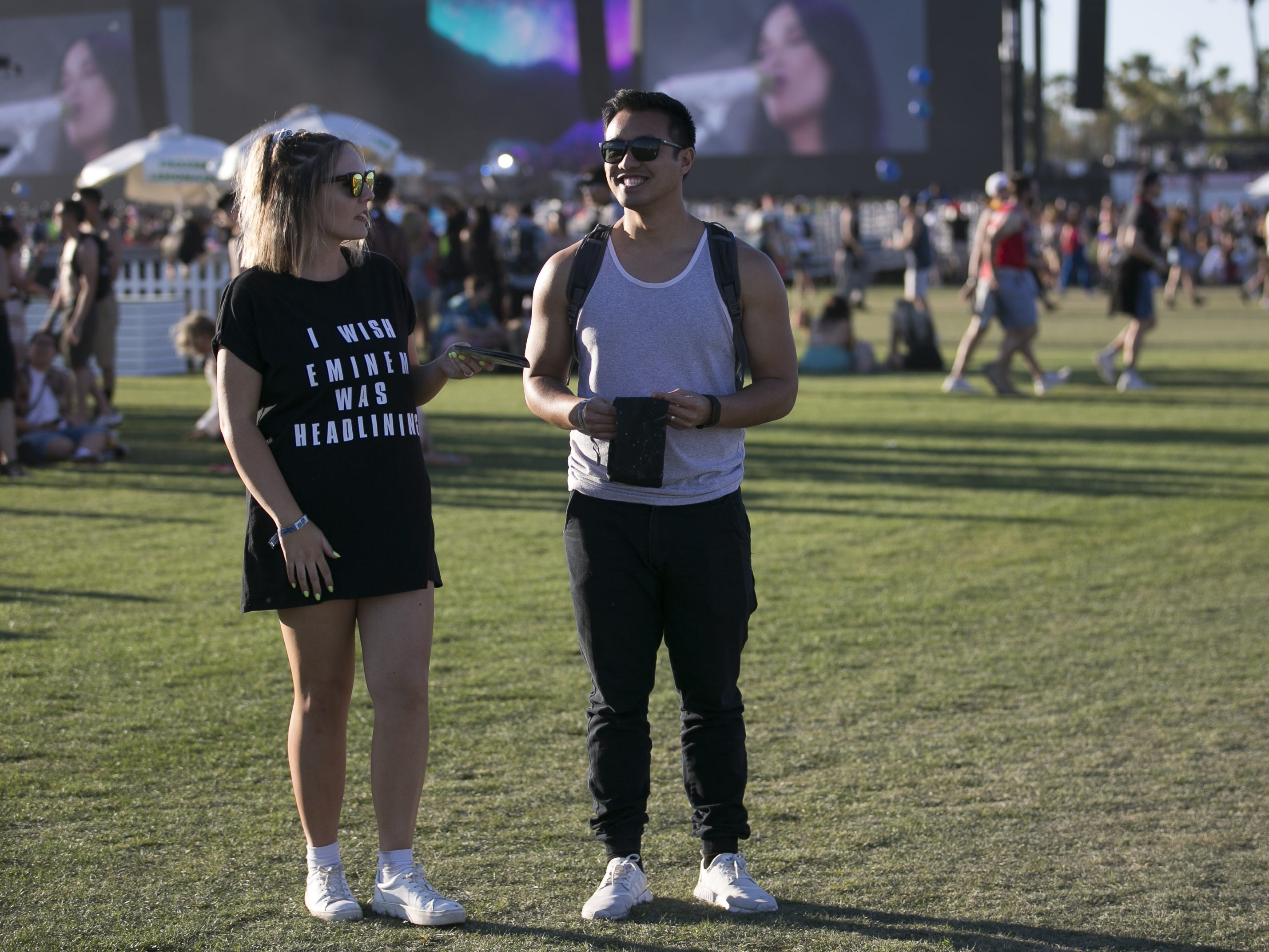 Holly Nguyen (left) and her husband Tuan Nguyen (right) walk through the grounds at the Coachella Valley Music and Arts Festival in Indio, Calif. on April 12, 2019.