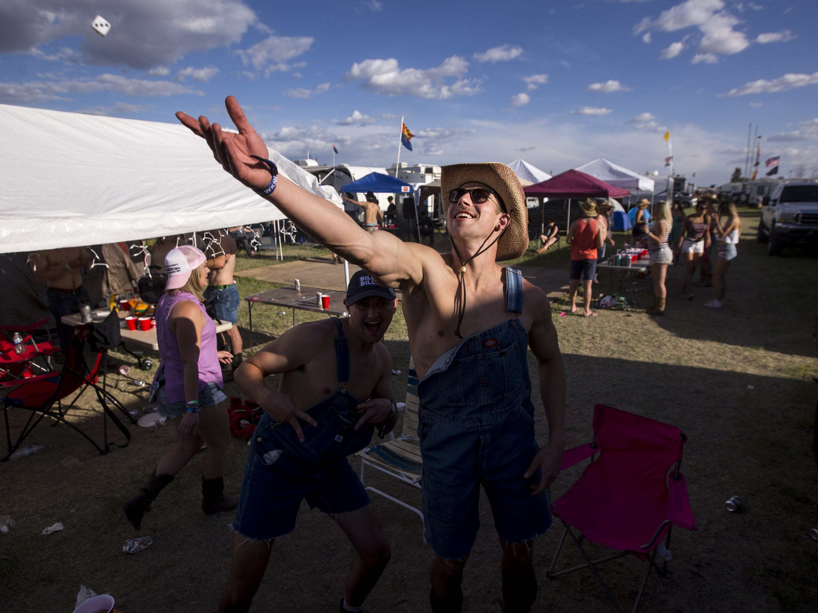 Zach Ondrejka plays beer die on Friday, April 12, 2019, during Day 2 of Country Thunder Arizona in Florence, Ariz.