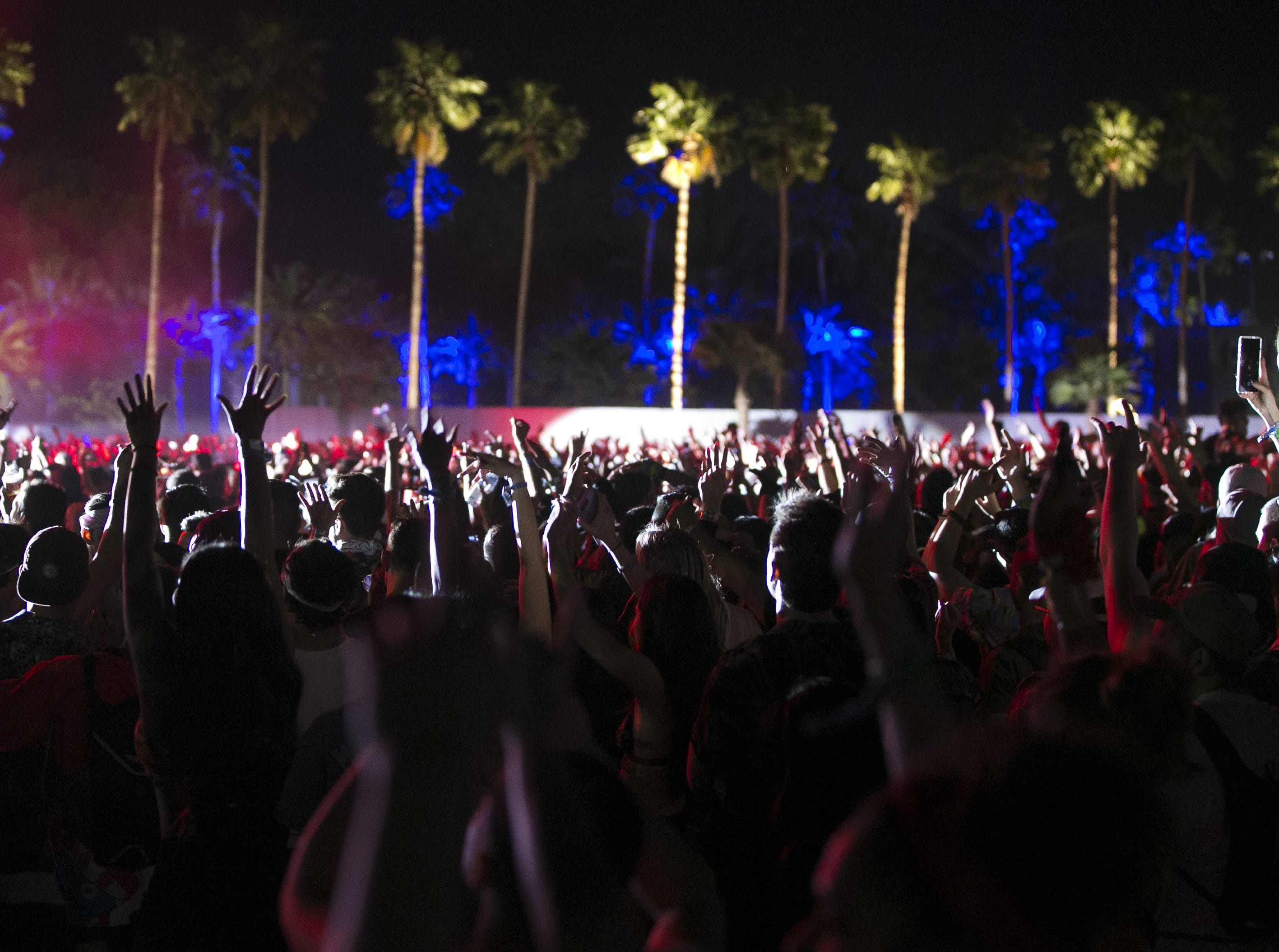 Festival-goers watch DJ Snake perform at the Coachella Valley Music and Arts Festival in Indio, Calif. on April 12, 2019.