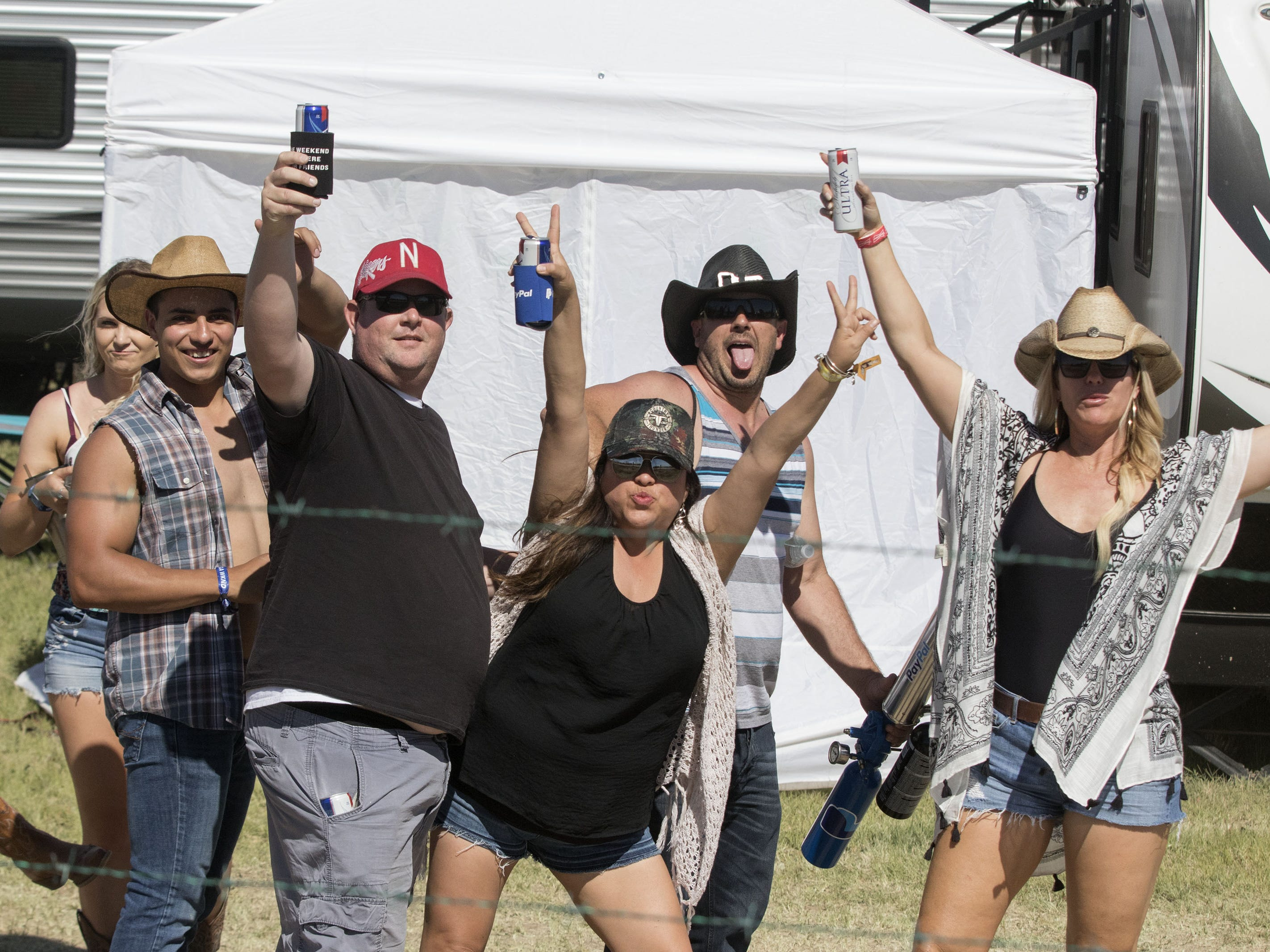 Festival-goers pose for a portrait during Country Thunder Arizona Saturday, April 13, 2019, in Florence, Ariz.