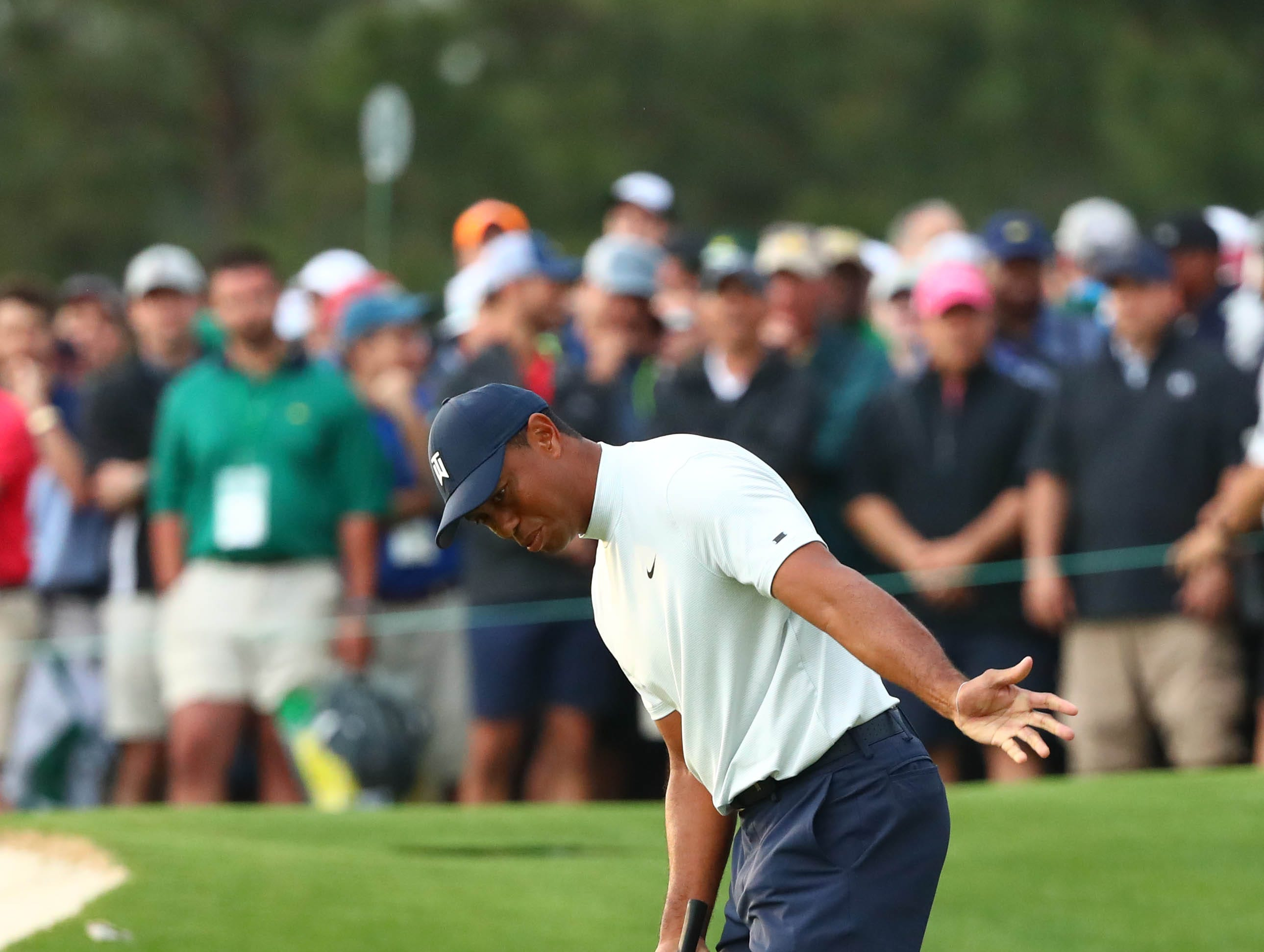 Apr 12, 2019; Augusta, GA, USA; Tiger Woods reacts after missing a putt on the 17th green during the second round of The Masters golf tournament at Augusta National Golf Club. Mandatory Credit: Rob Schumacher-USA TODAY Sports