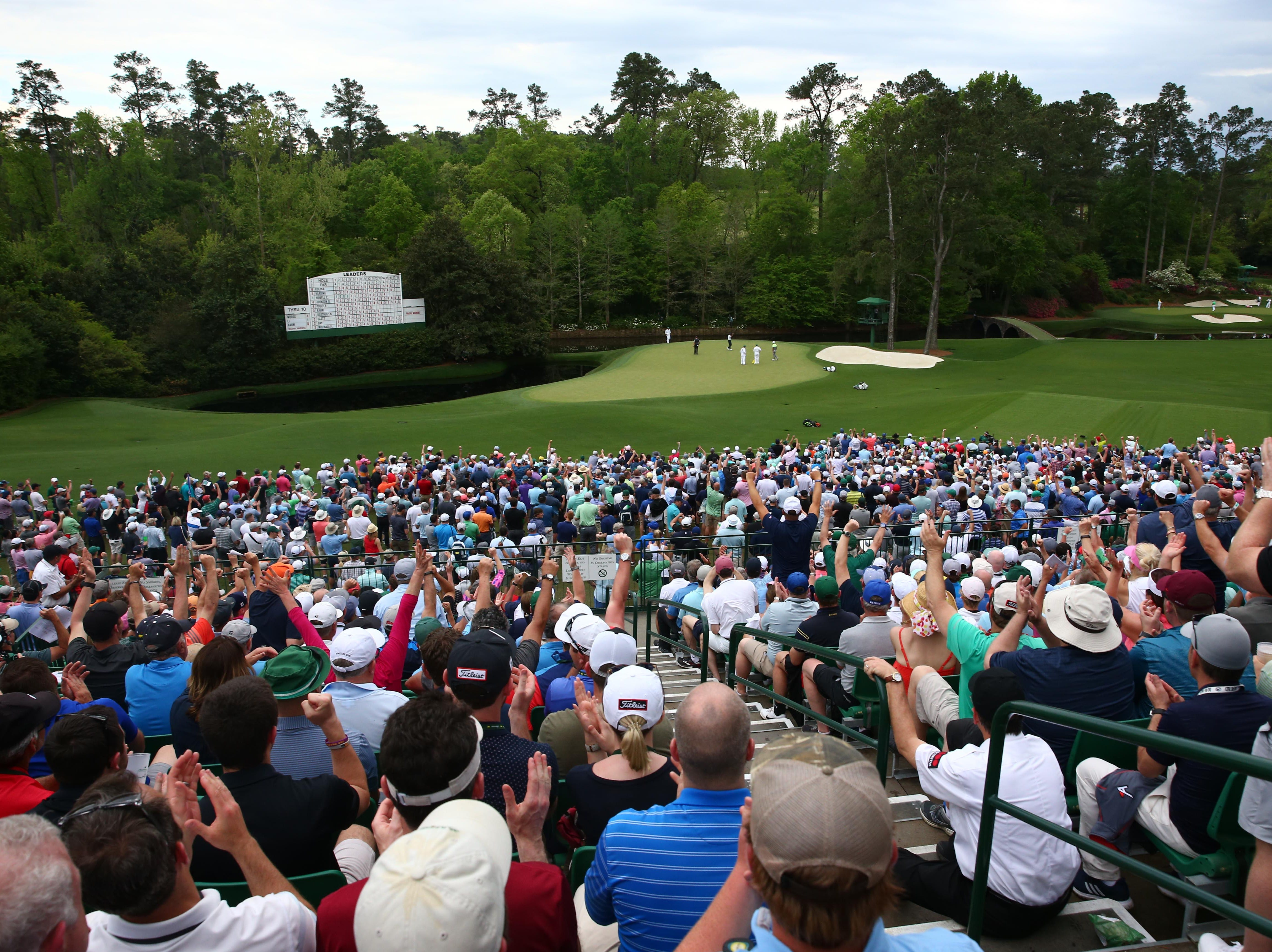 Apr 12, 2019; Augusta, GA, USA; The crowd reacts to a birdie by Tiger Woods on the 11th green during the second round of The Masters golf tournament at Augusta National Golf Club. Mandatory Credit: Rob Schumacher-USA TODAY Sports