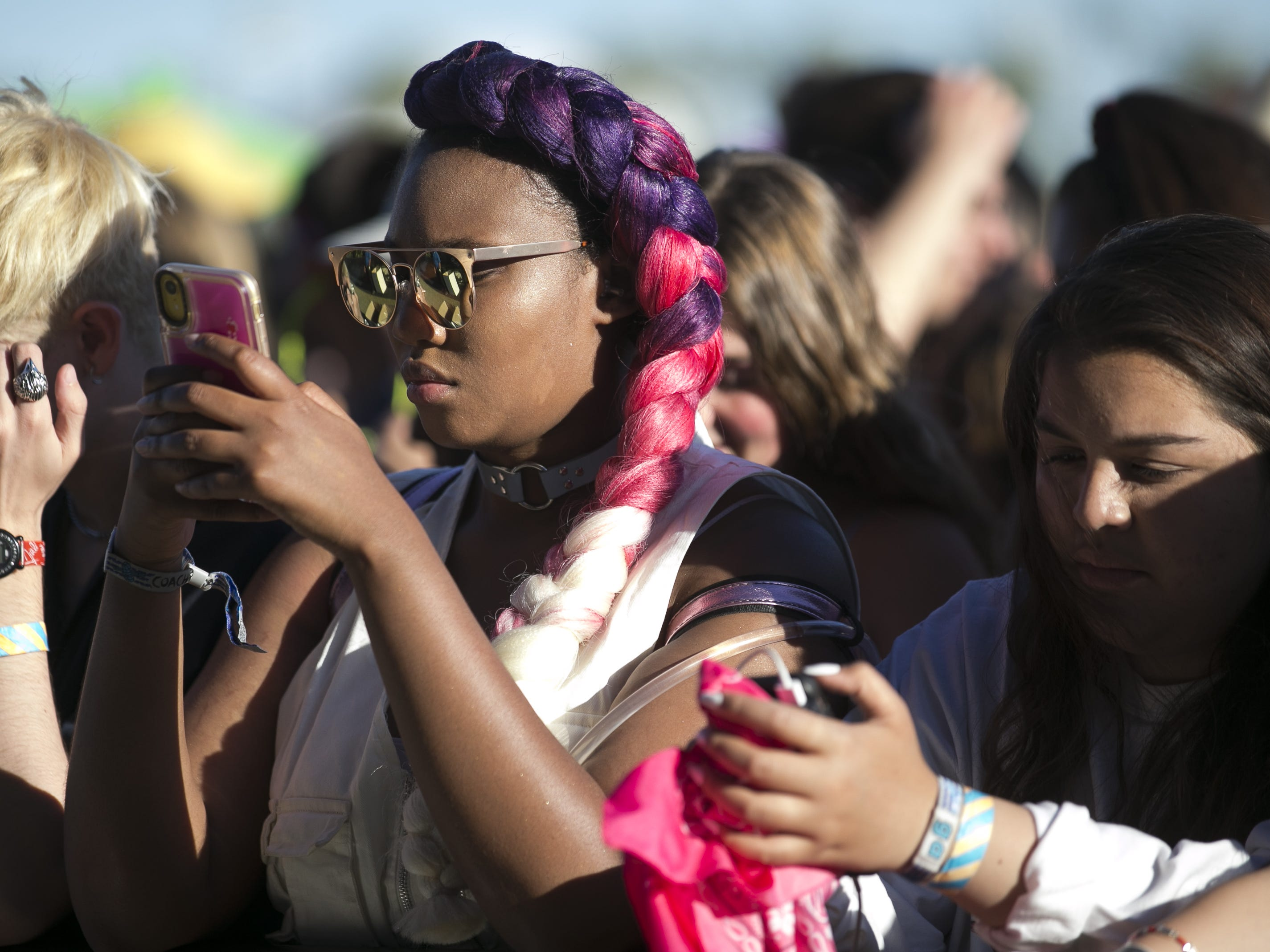 Festival-goers wait at the main stage in between sets at the Coachella Valley Music and Arts Festival in Indio, Calif. on April 12, 2019.