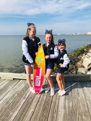 Dover freshman Emily Carr poses alongside teammates Natalie Schultz and Isabella Pace after helping Dutchess Premier Cheer win a national all-star tournament in Maryland last week.