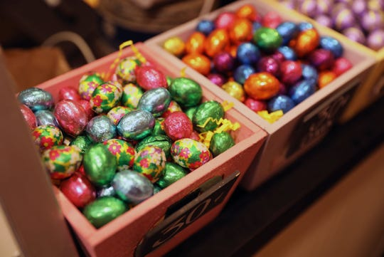 Chocolate foil eggs sit on a counter at Samuel's Sweet Shop in Rhinebeck, April 13, 2019. The shop is celebrating it's 25th anniversary this month.