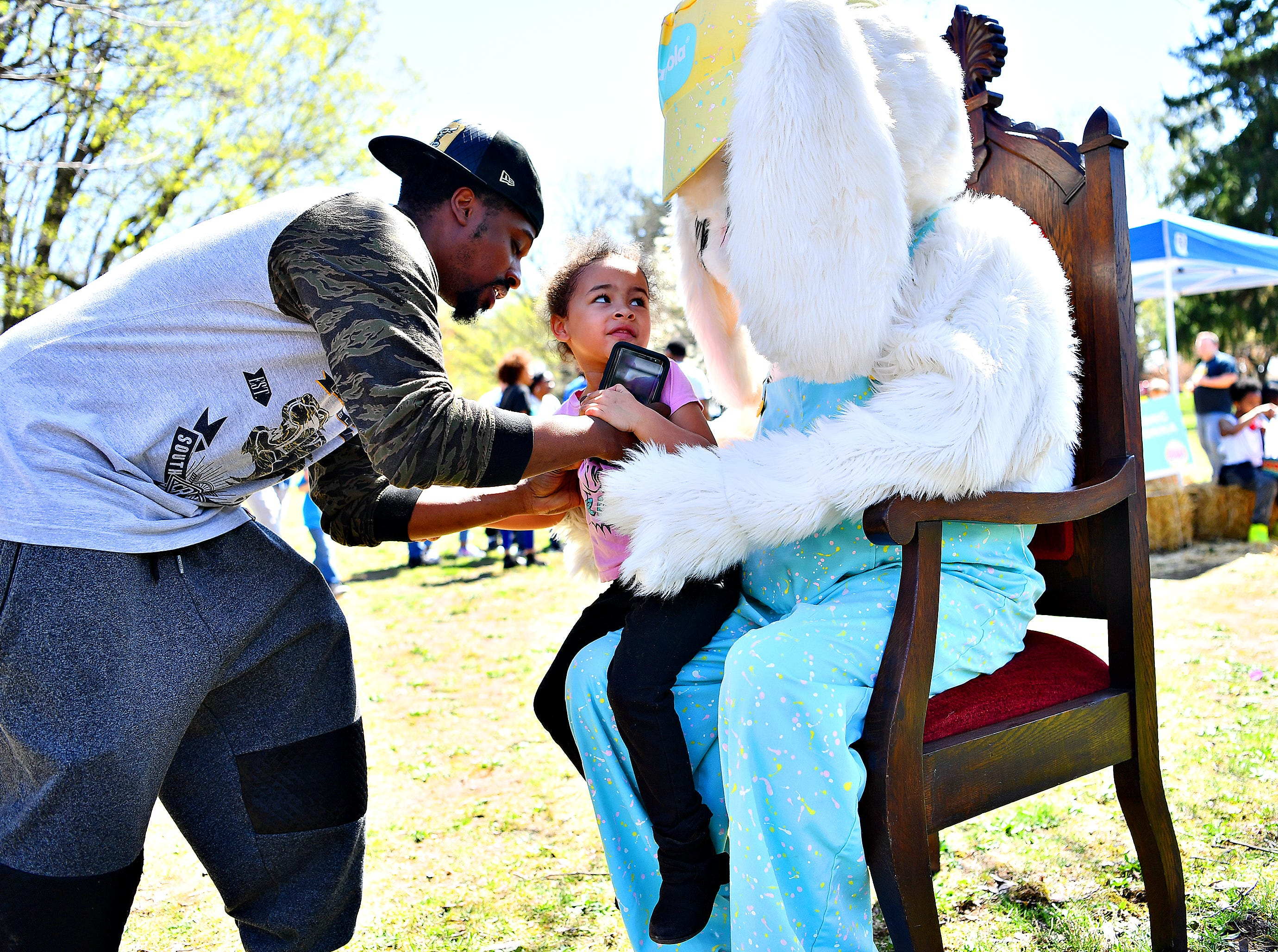 The Easter Bunny poses for photos with children during the 44th Annual York City Easter Egg Hunt at Kiwanis Lake in York City, Saturday, April 13, 2019. Dawn J. Sagert photo