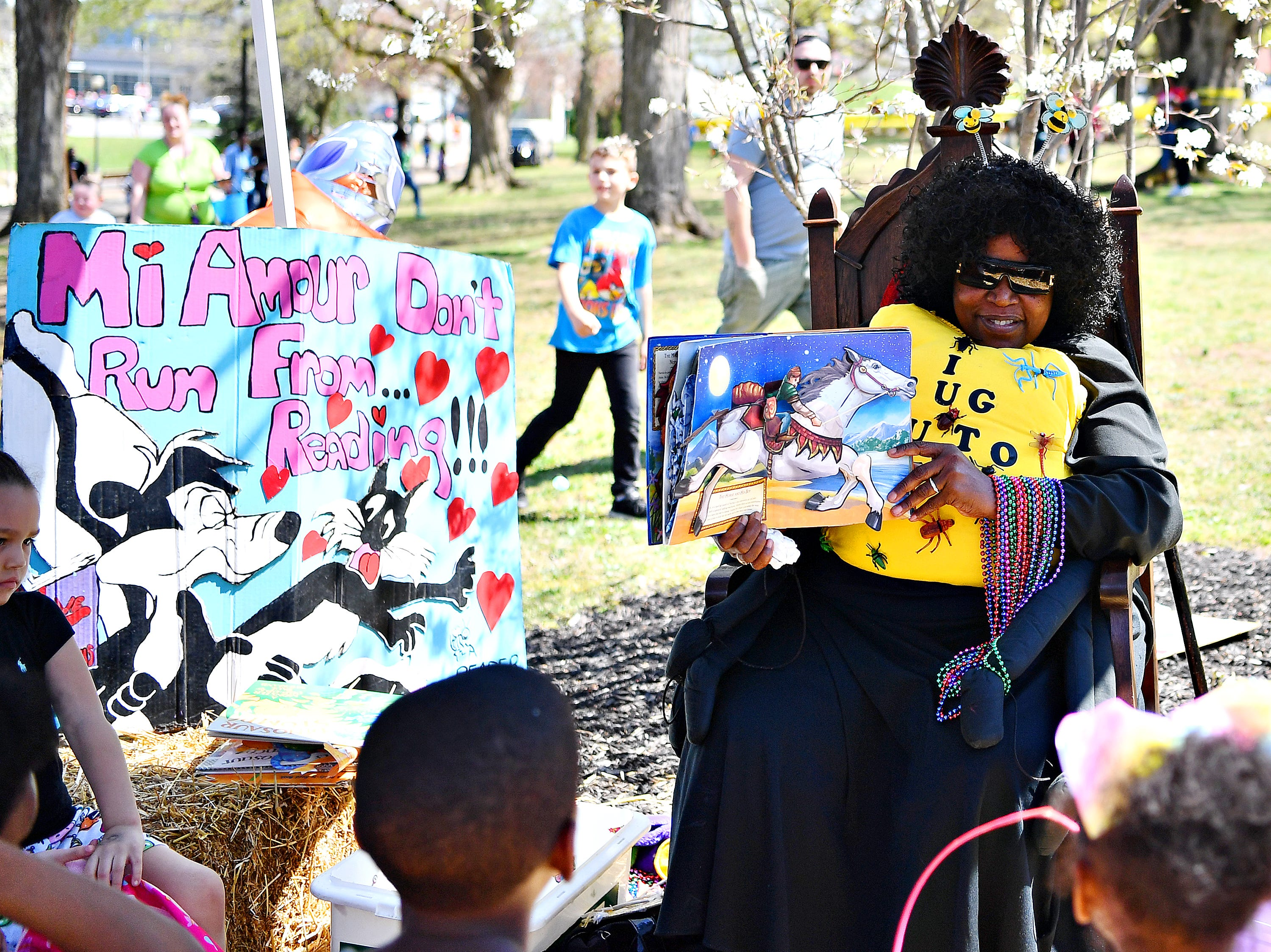 "Donna Watkins, A.K.A. ""The Reading Bug,"" of York City, reads to children during the 44th Annual York City Easter Egg Hunt at Kiwanis Lake in York City, Saturday, April 13, 2019. Dawn J. Sagert photo"