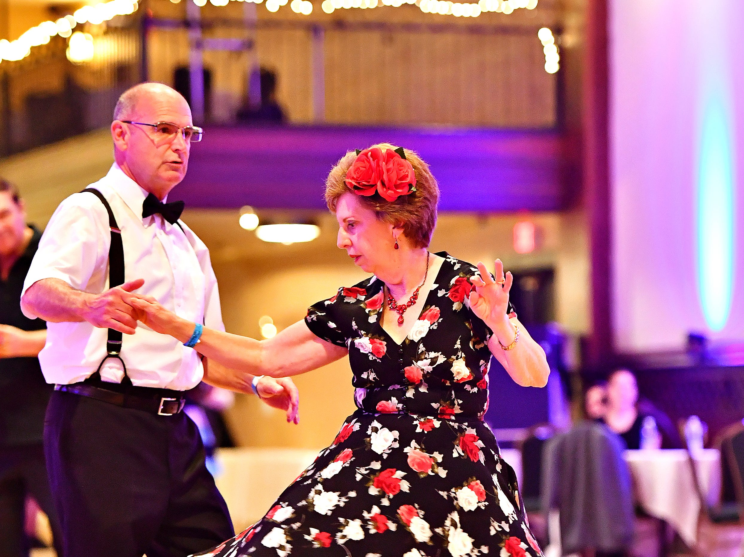 Bill Snider, left, of Culpeper, Va., and Theresa Dagenhart, of Burke, Va., dance as Parlour Noir performs during Big Swing Thing III Premiere Swing Music & Dance Festival at Valencia Ballroom in York City, Friday, April 12, 2019. Dawn J. Sagert photo