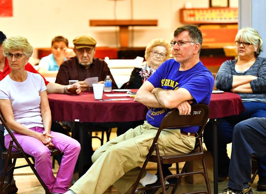 Wayne Wurzbacher, front, looks on as New Freedom Brorough Council candidates speak in New Freedom, Saturday, April 13, 2019. Dawn J. Sagert photo