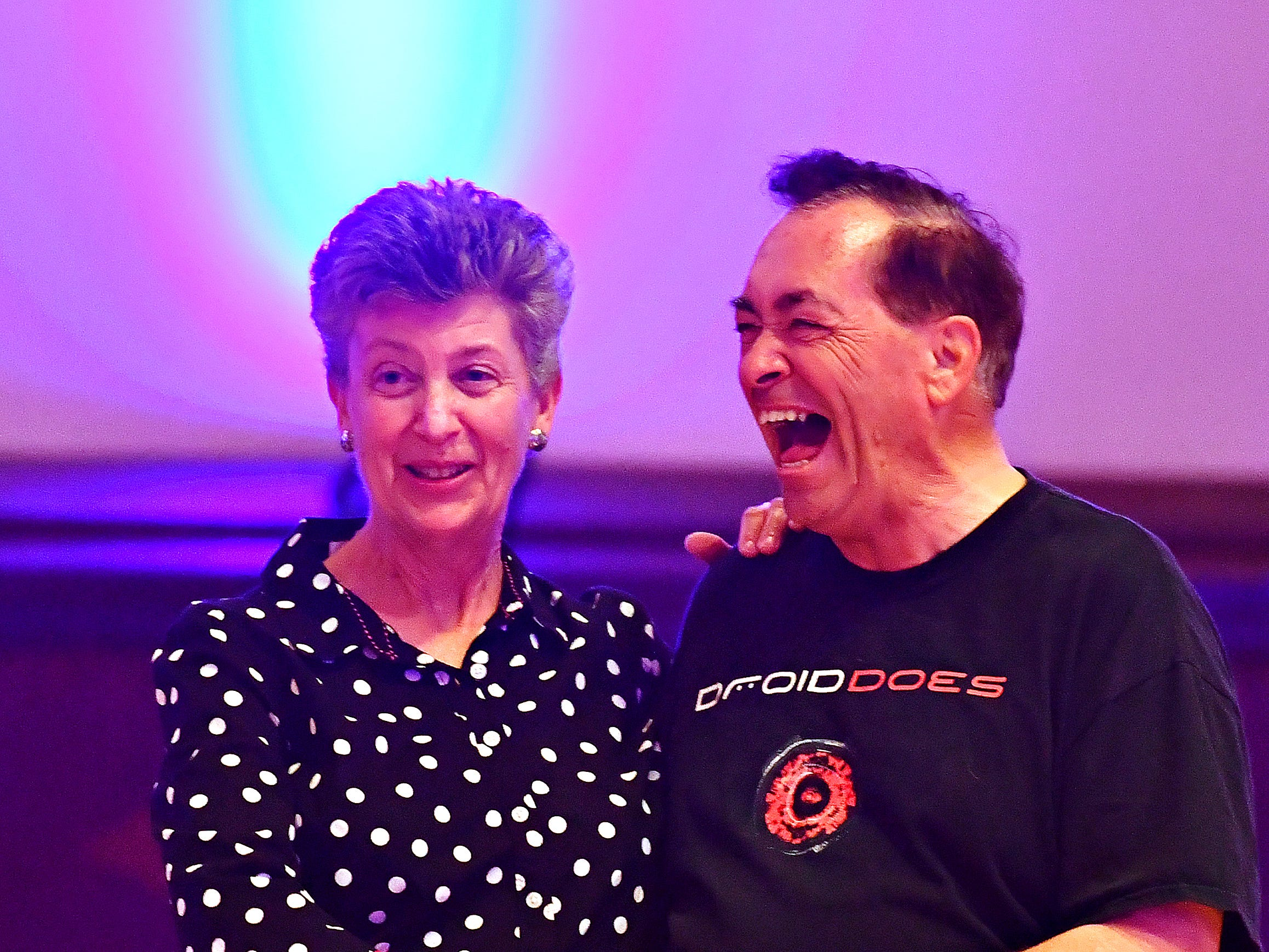 Lynn Harris, left, of Winchester, Va., and Leslie Schuermann, of Culpeper, Va., share a laugh as they participate in a Swing Class Crash Course during Big Swing Thing III Premiere Swing Music & Dance Festival at Valencia Ballroom in York City, Friday, April 12, 2019. Dawn J. Sagert photo