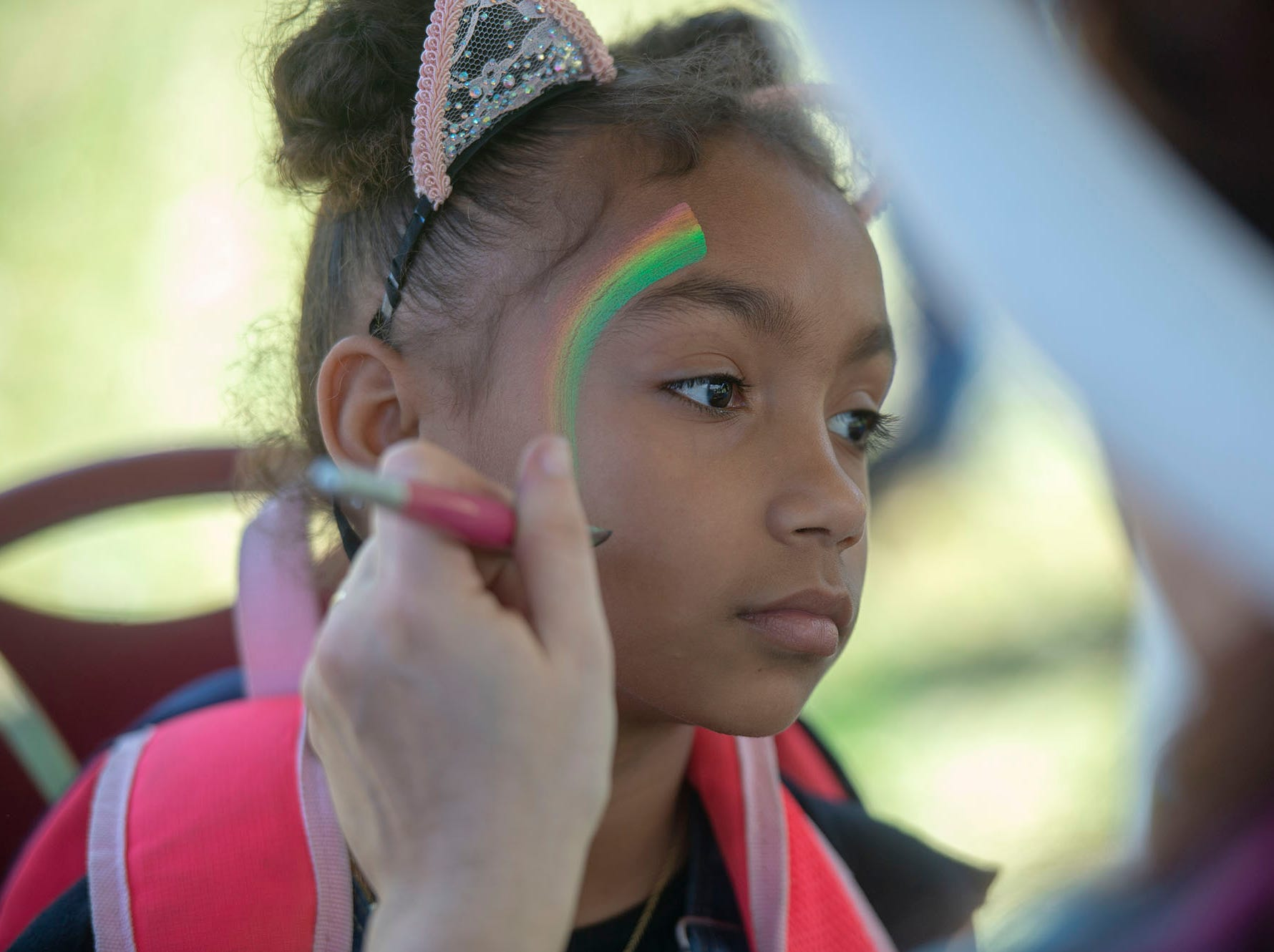 Rainbows were among the designs at the face painting booth at the City of York's Easter Egg Hunt at Kiwanis Lake on Saturday, April 13, 2019.