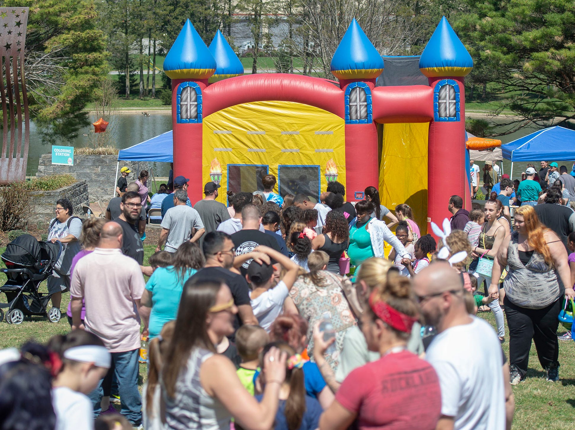It only took a few minutes for a long line to form for the bounce house at the City of York's Easter Egg Hunt at Kiwanis Lake on Saturday, April 13, 2019.