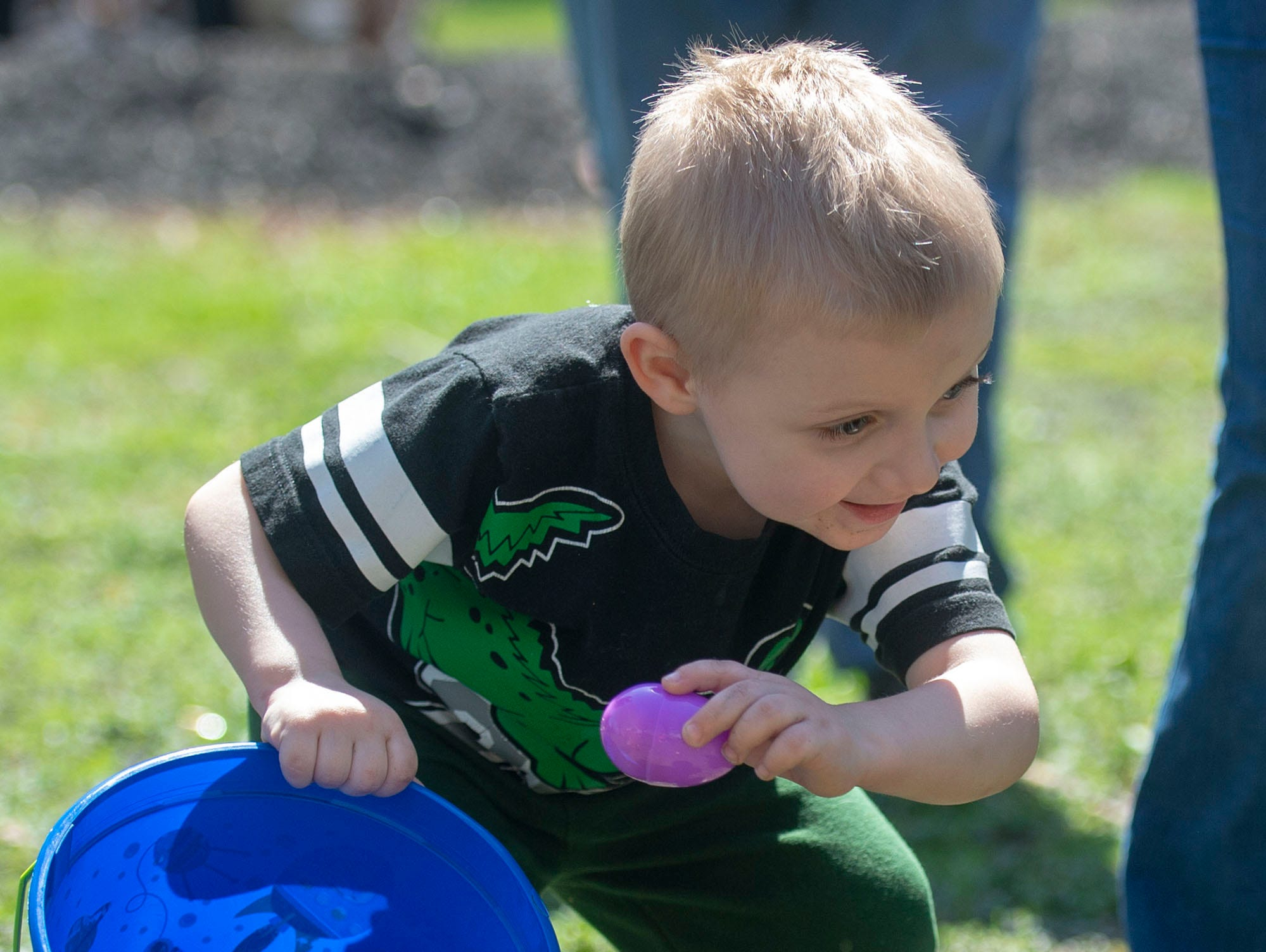 This purple egg is going in the bucket during the 1-3-year-old division at the City of York's Easter Egg Hunt at Kiwanis Lake on Saturday, April 13, 2019.
