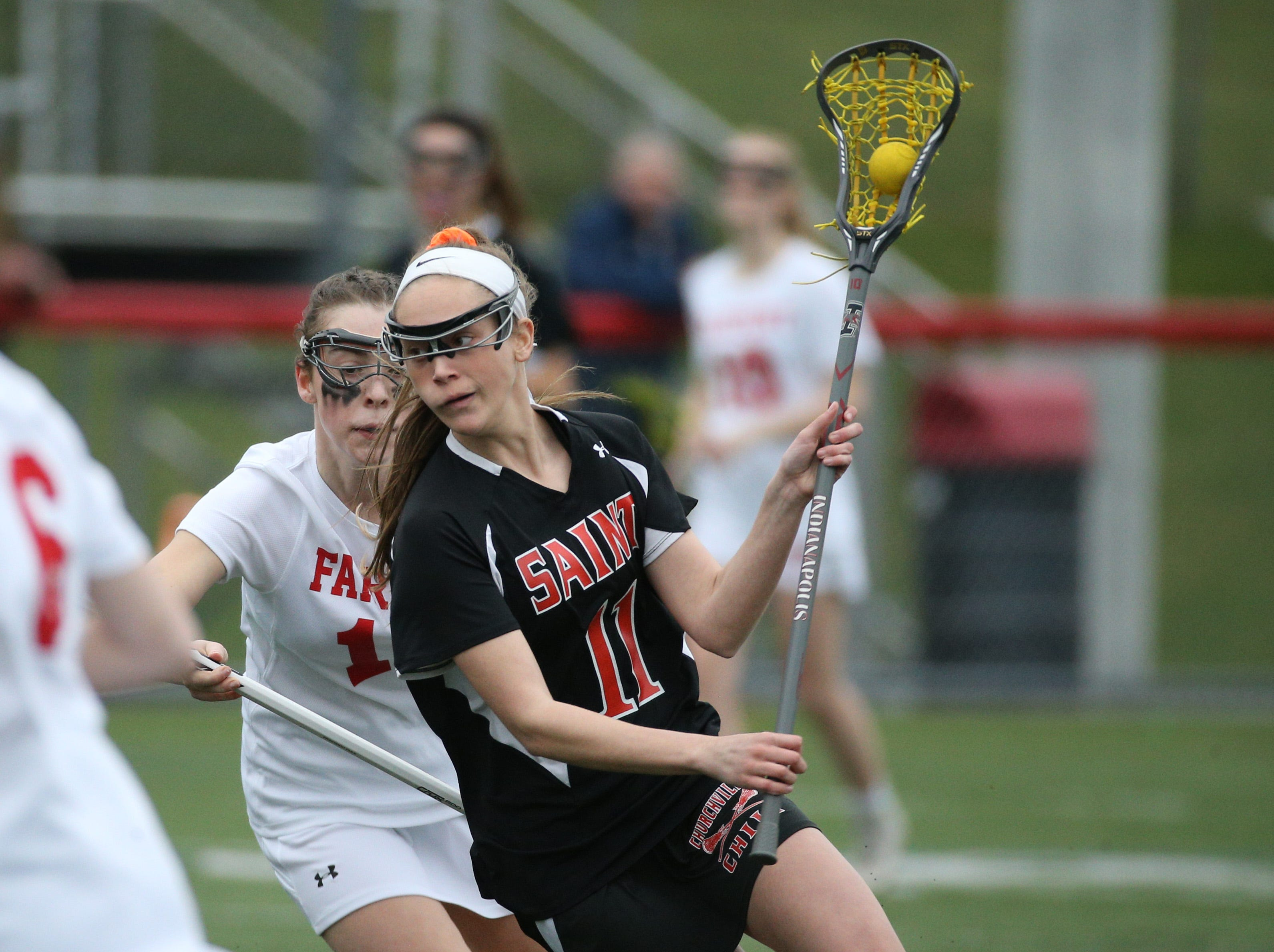 Churchville-Chili's Kayla Wiest carries the ball against Fairport.
