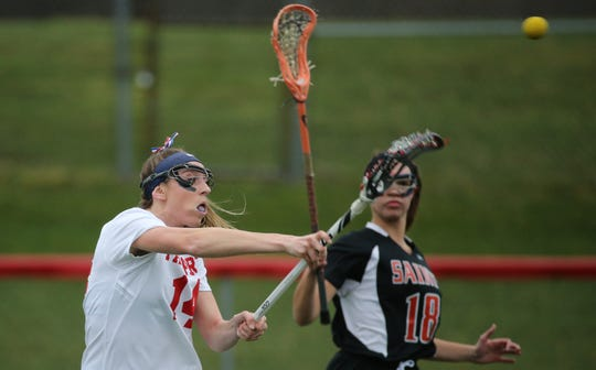 Fairport's Morgan Schwab shoots around Churchville-Chili's Breann Giacolone (18).