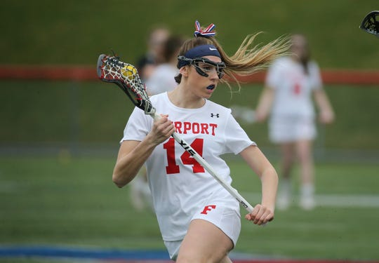 Fairport's Morgan Schwab looking for space to shoot against Churchville-Chili.