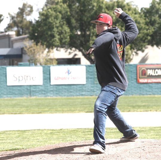 Caleb Stoke, the son of Redding firefighter Jeremy Stoke who died in the Carr Fire, throws out the first pitch at Tiger Field on Saturday. Simpson University's baseball team hosted Marymount California University for a doubleheader on First Responders Day.