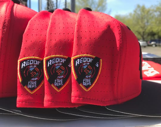 Simpson University baseball hats were on sale Saturday with a memorial Jeremy Stoke patch. Fans who bought the hat for $30 got in free to Saturday's doubleheader. Proceeds from the hat sales go to the university's Carr and Camp Fire Scholarship program.