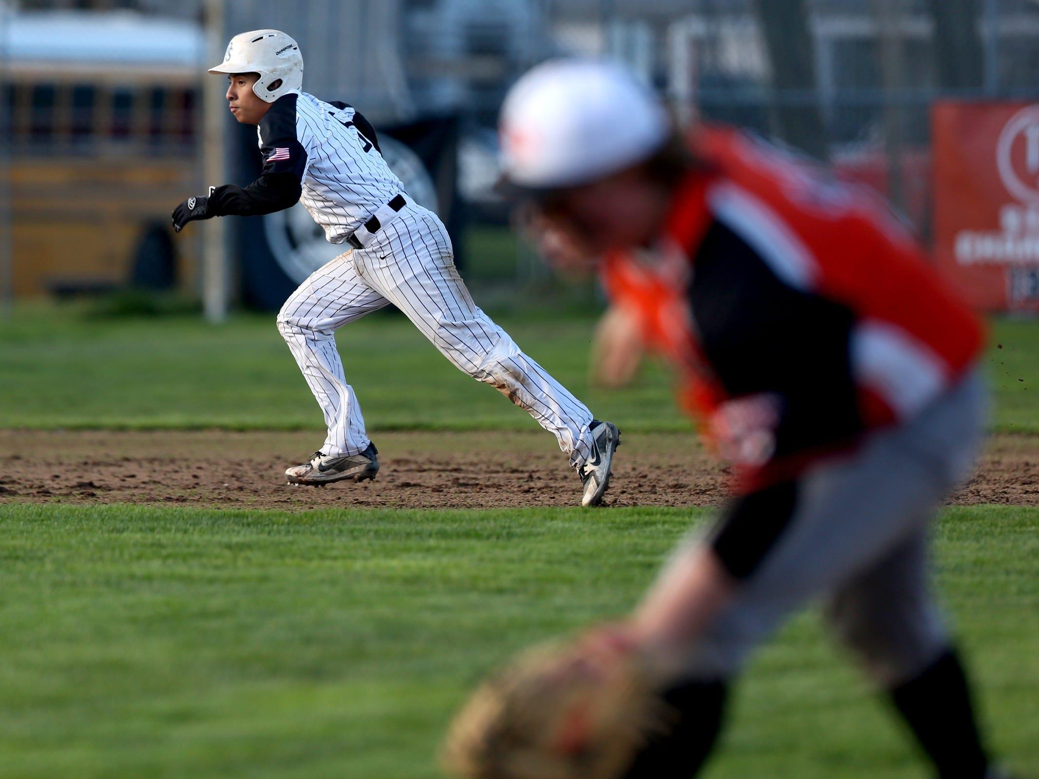 North Salem's Brian Bernal (5) runs to third in the Dallas vs. North Salem baseball game in Salem on April 12, 2019.