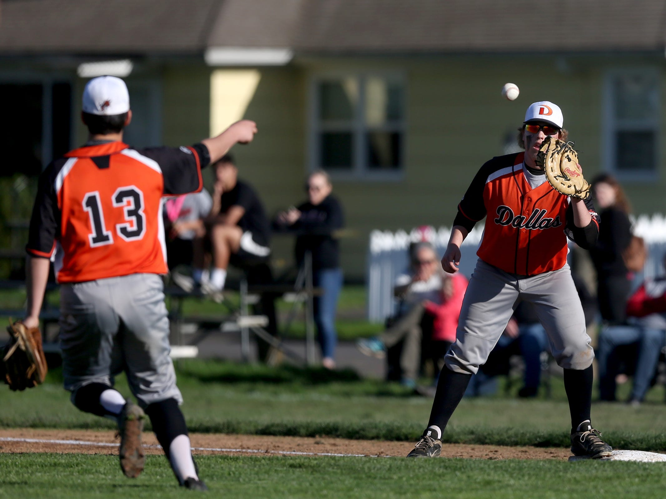The Dallas first baseman makes a catch for an out from the pitcher in the Dallas vs. North Salem baseball game in Salem on April 12, 2019.