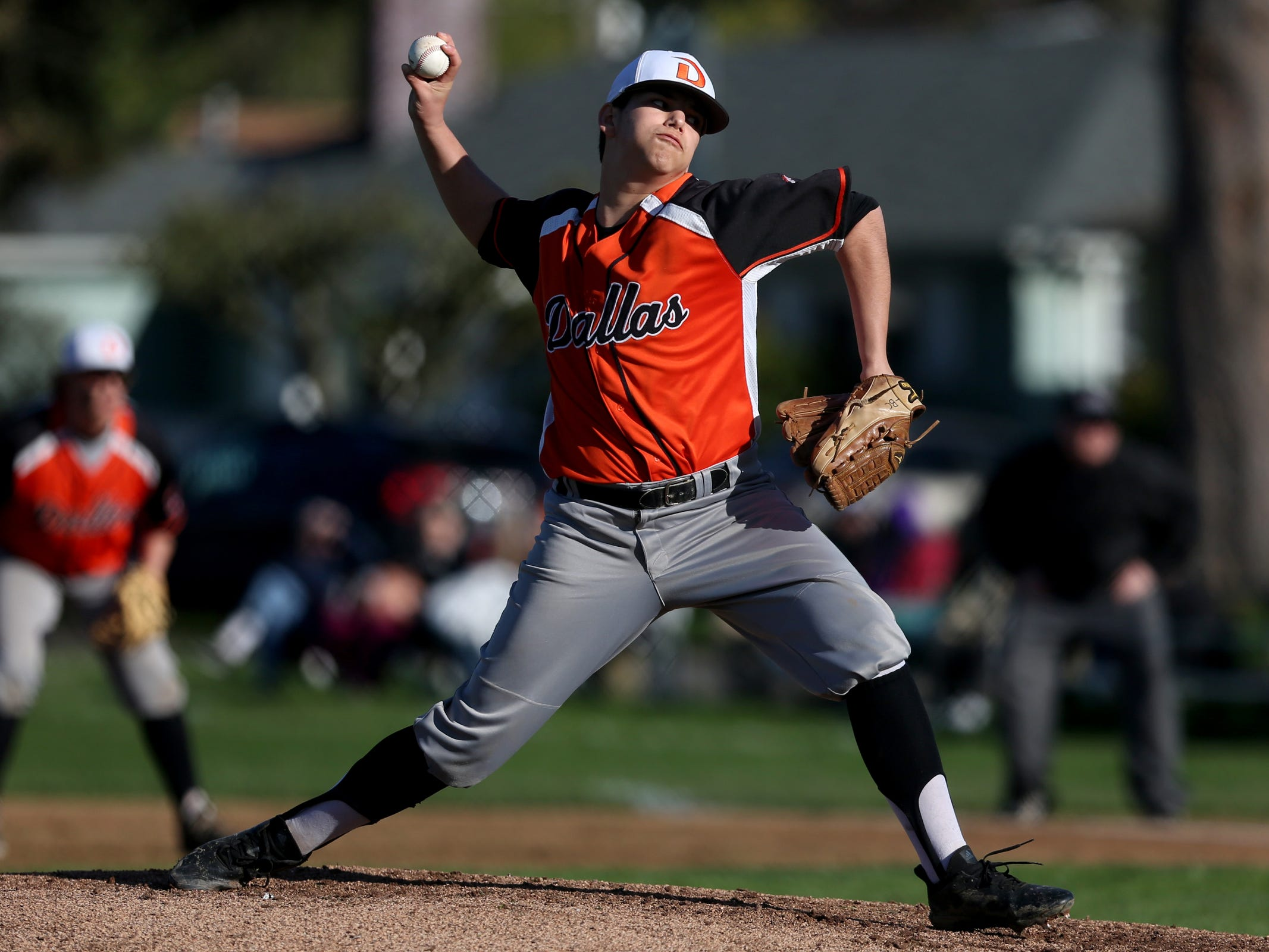 A Dallas player pitches in the Dallas vs. North Salem baseball game in Salem on April 12, 2019.
