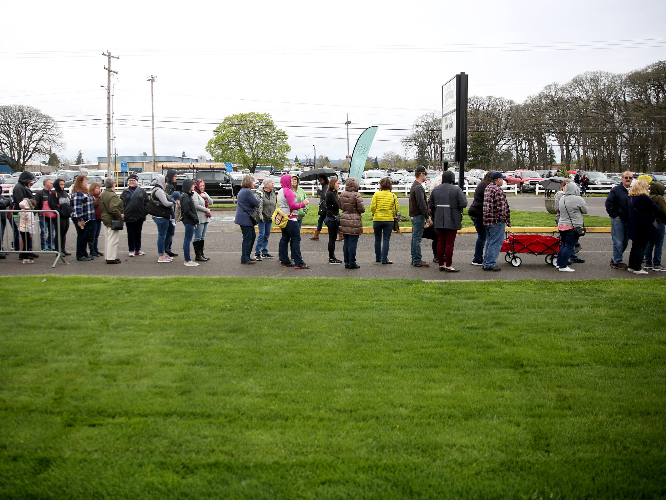 Hundreds of people wait in line for the doors to open for The Great Junk Hunt, a traveling vintage market, at the Oregon State Fairgrounds in Salem on April 13, 2019.