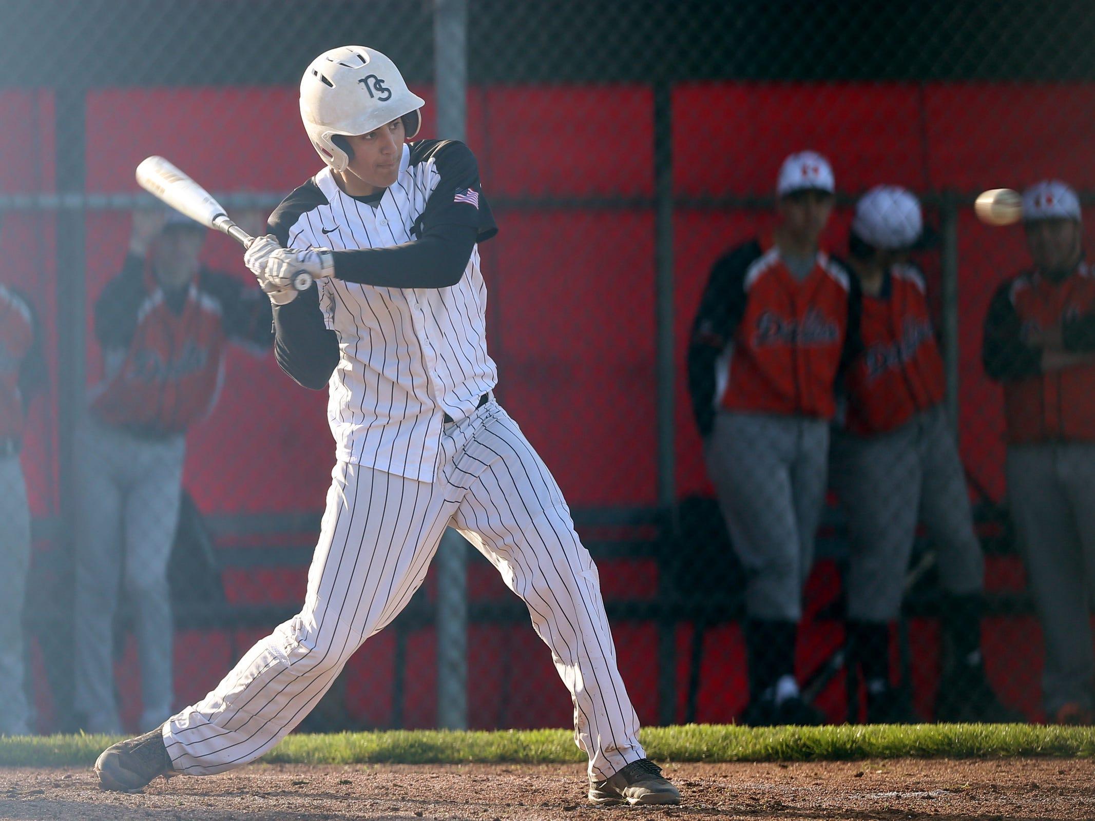 North Salem's Dylan Ebbs (14) bats in the Dallas vs. North Salem baseball game in Salem on April 12, 2019.