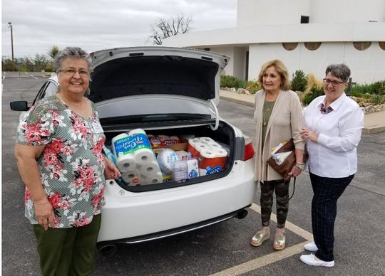 Members of the Angelo Women's Social Club answered the news article about needed supplies from Safe Harbor Family Shelter by donating and delivering a trunk-load of items on their list. From left: Terri Bomberger, President; Billie Myers, Community Outreach Chair; Noreen Carpenter, Program and Sunshine Chair.