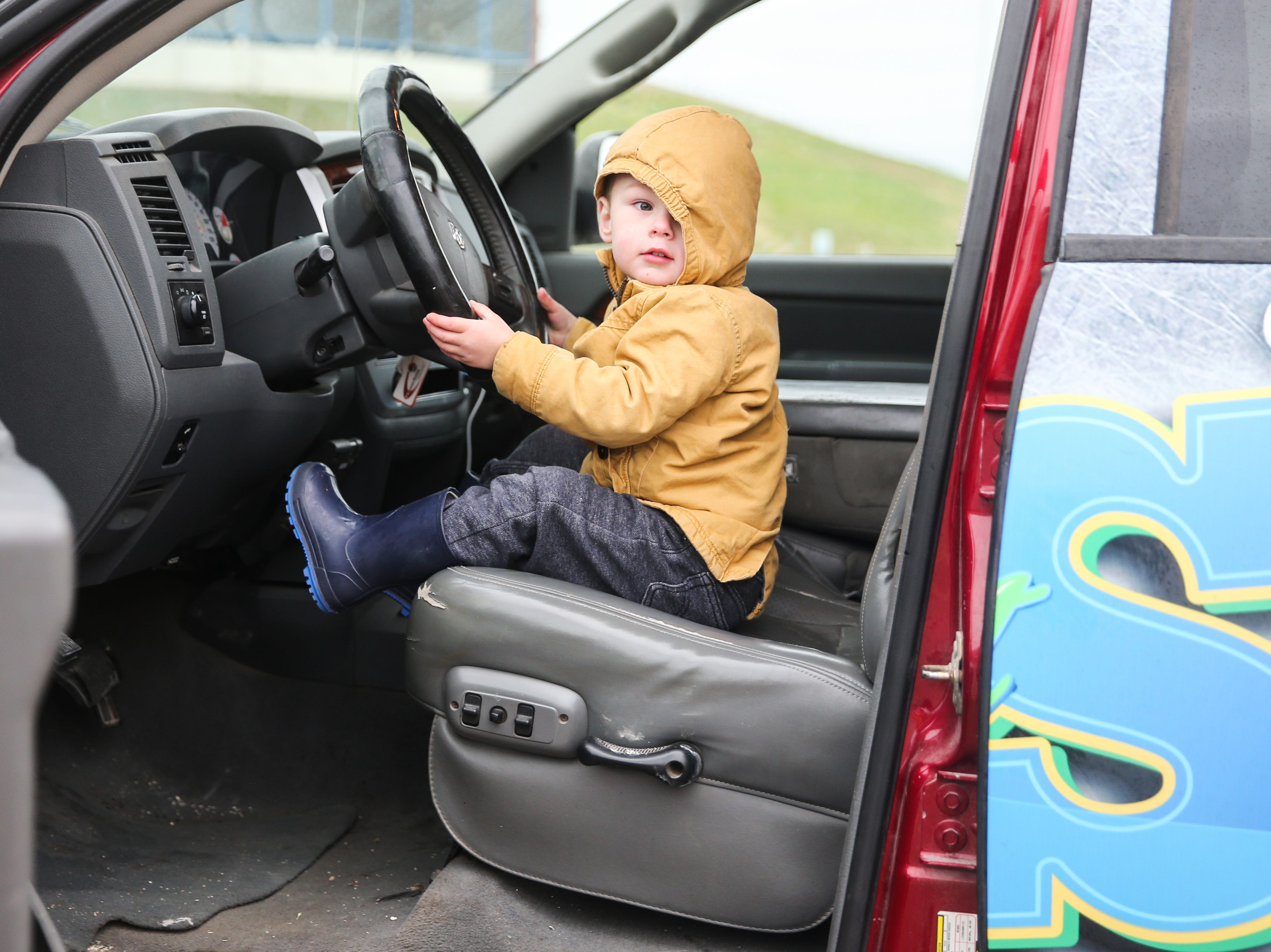 Reign Calvert sits behind the wheel of a truck during Touch-a-Truck event Saturday, April 13, 2019, at San Angelo Stadium.