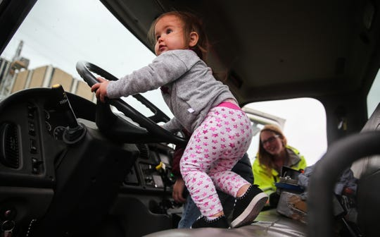 Emmeline Wallar, 1 climbs into the fire truck during Touch-a-Truck event Saturday, April 13, 2019, at San Angelo Stadium.