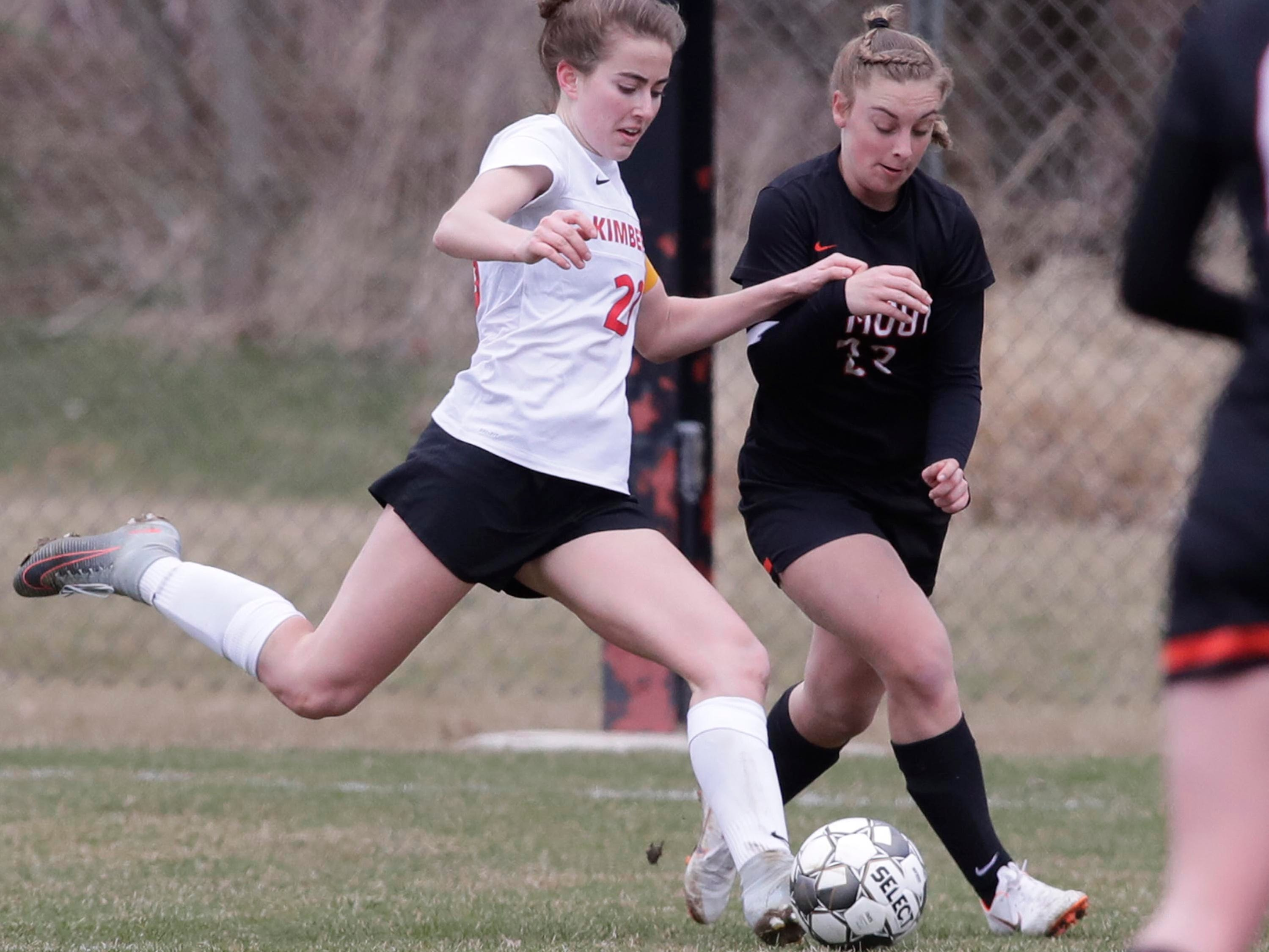 Kimberly's Elsi Twombly (23) aims her kick that would score by Plymouth's Dallas Kreisa (23, right), Saturday, April 13, 2019, in Plymouth, Wis.