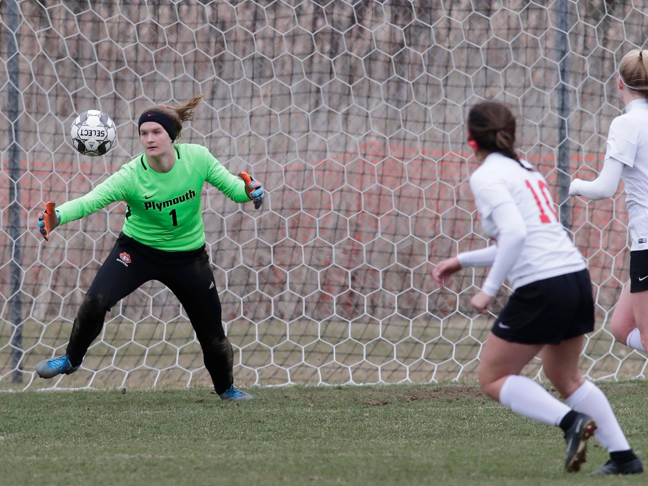 Plymouth goaltender Tess Huhn (1) aims to catch the ball against Kimberly, Saturday, April 13, 2019, in Plymouth, Wis.