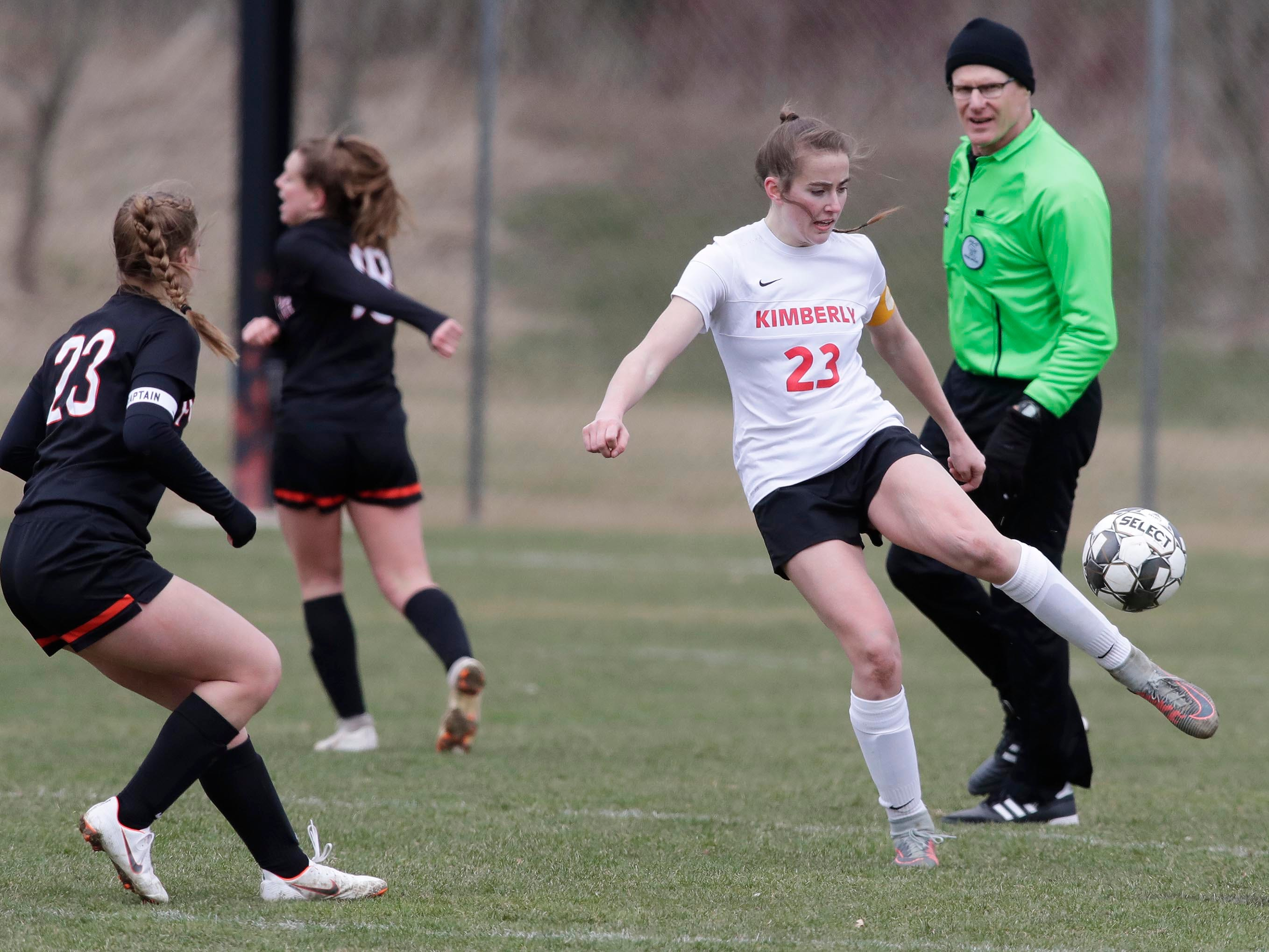 Kimberly's Elsi Twombly (23) kicks the ball against Plymouth, Saturday, April 13, 2019, in Plymouth, Wis.