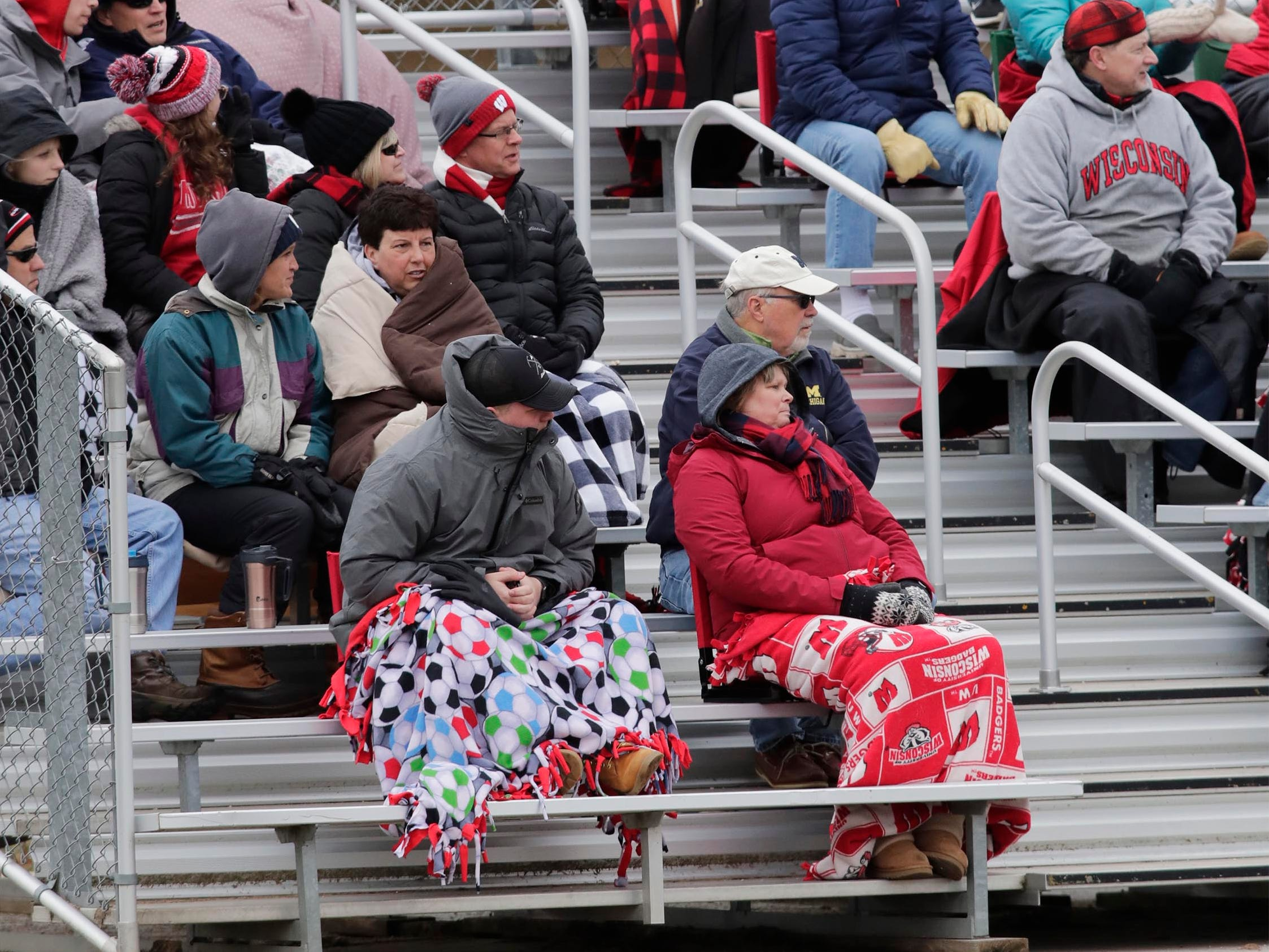 Fans watch Kimberly at Plymouth action bundled in the stands, Saturday, April 13, 2019, in Plymouth, Wis.