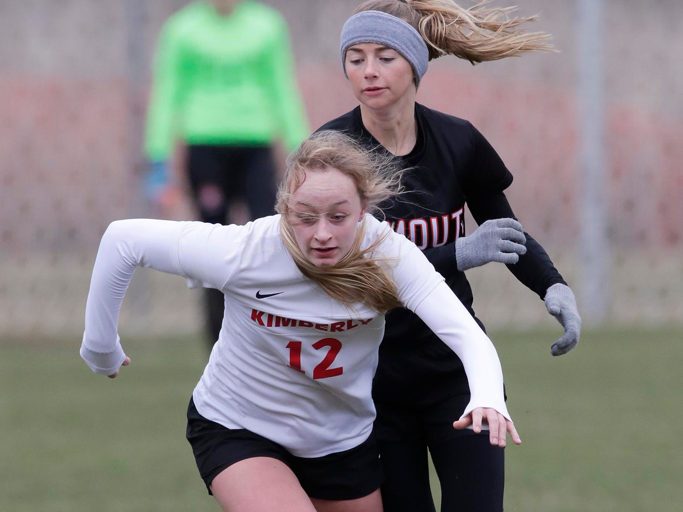 Kimberly's Lauryn Hull (12) runs to the ball against Plymouth, Saturday, April 13, 2019, in Plymouth, Wis.