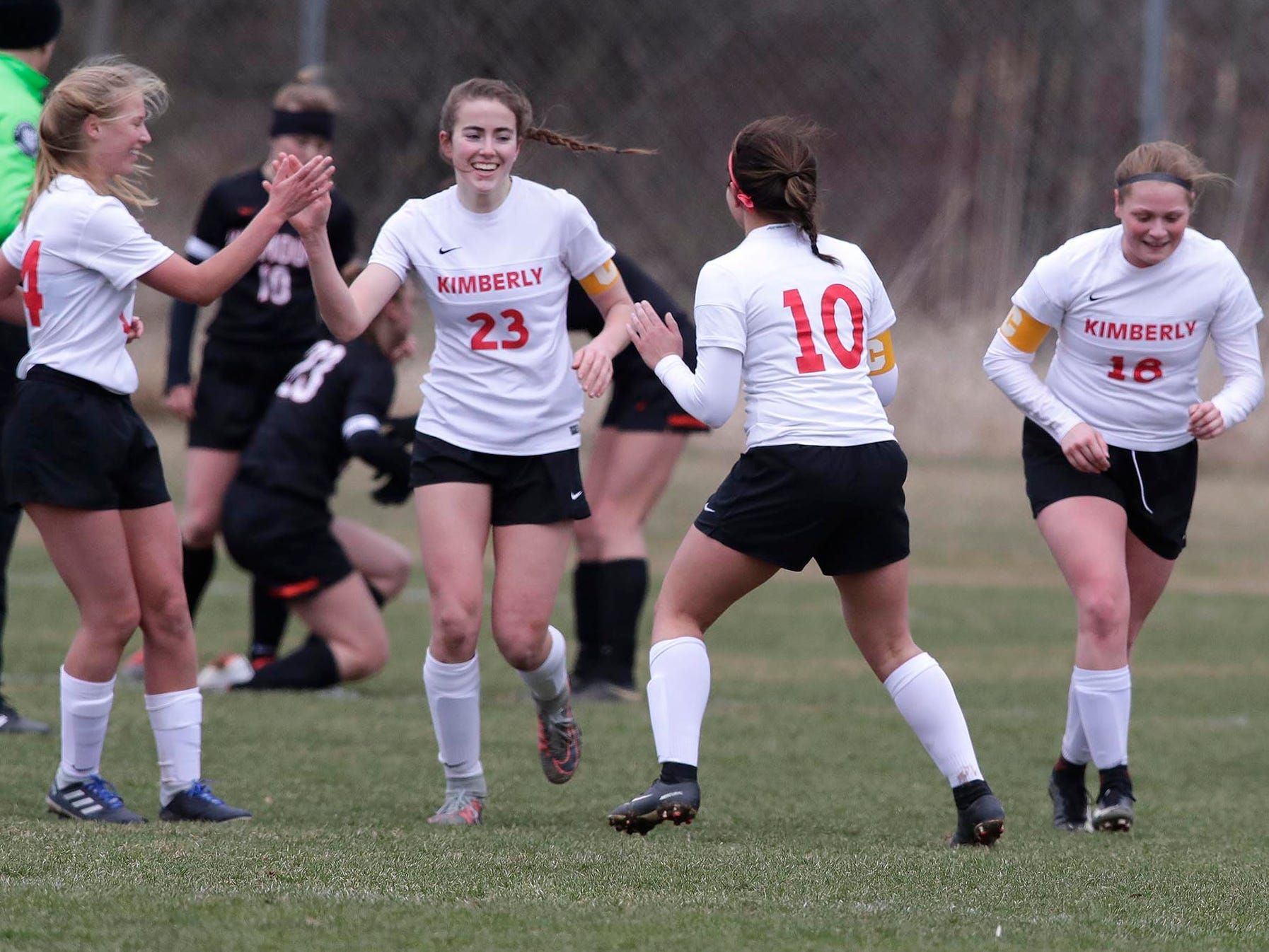 Kimberly's Elsi Twombly (23) celebrates her goal against Plymouth, Saturday, April 13, 2019, in Plymouth, Wis.