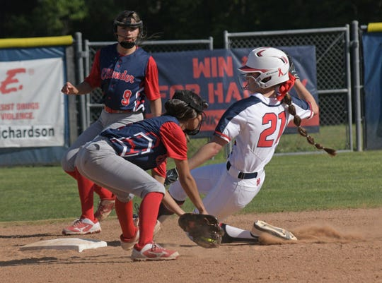 North DeSoto's Bailey McMillian slides into second against Ellender.
