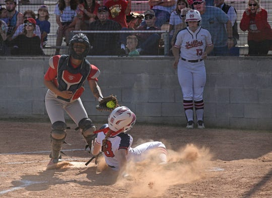 North DeSoto's Laken Martin slides into home against Ellender Friday in Stonewall in the 2019 LHSAA Class 4A state playoffs.